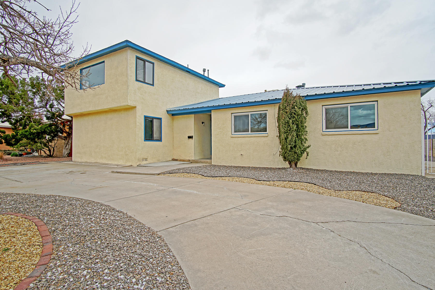 $15000 Price Reduced! WOW! Newly Remodeled and a great views of the Sandia Mountain.  Very large home featuring 5 Bedrooms, 4 Baths, 2 living areas and an open floor plan.  Complete kitchen upgrade includes: granite countertops, cabinets doors and paint, and new appliances all around. New beautiful tile flooring in wet areas and kitchen. Newly stained hard wood flooring, almost all windows replaced. Freshy painted walls and ceilings, Oversized backyard and sideyard. Backyard access. Great location! Must See!