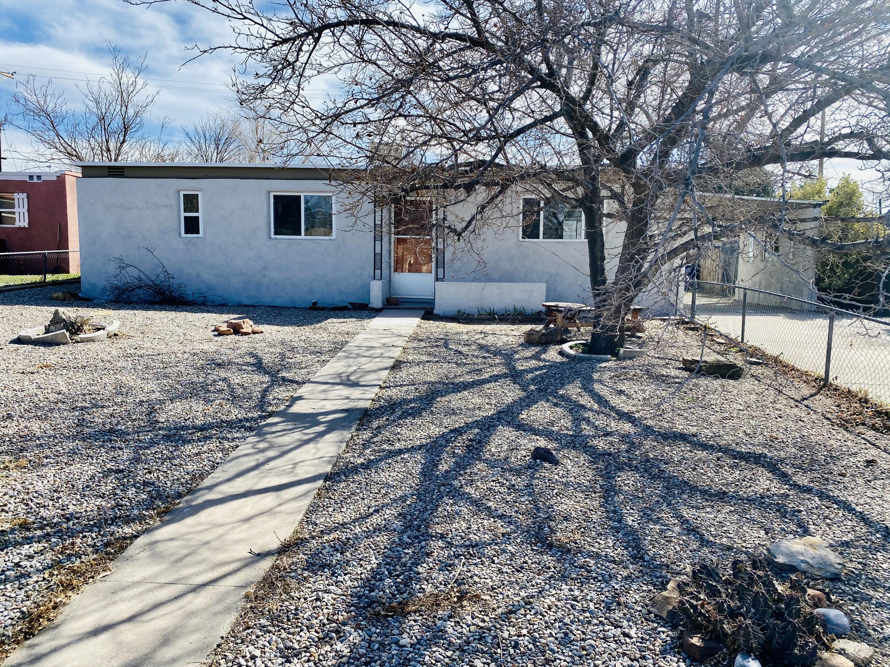 Cute move in ready home!  New roof and stucco in 2021.   All kitchen appliances stay.  Vinyl floors and all new carpet!  New paint and new countertops.  Looks great and centrally located.  Backyard access!  This home will not last long!