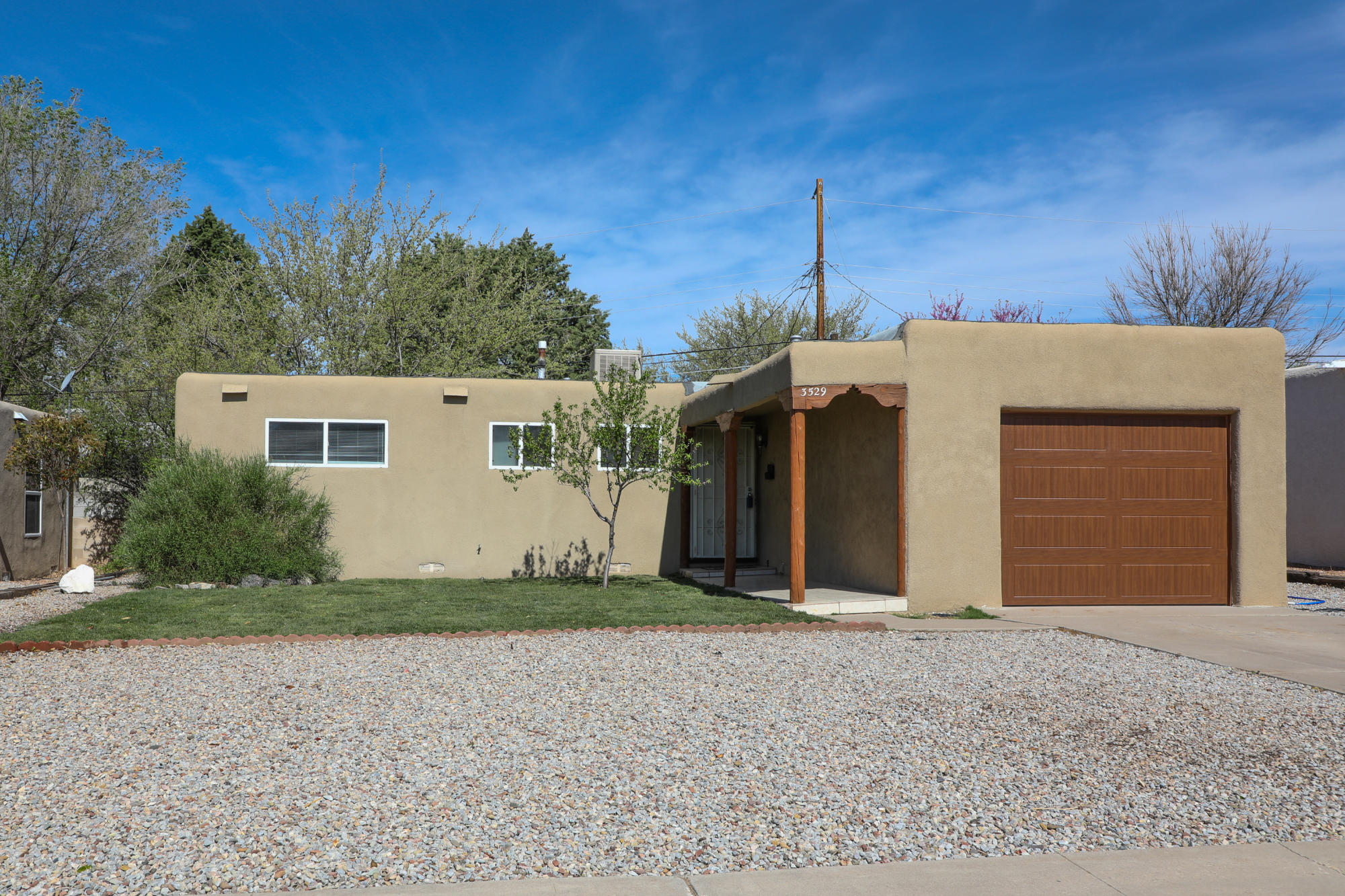 Come see this beautiful well-maintained home in the heart of Albuquerque! Nearby shopping, schools, and entertainment! Decorative wooden beams and corbels outside with a view of the Sandias. Refinished original hardwood floors. The home was updated with a new heater and evaporative cooler in 2016.