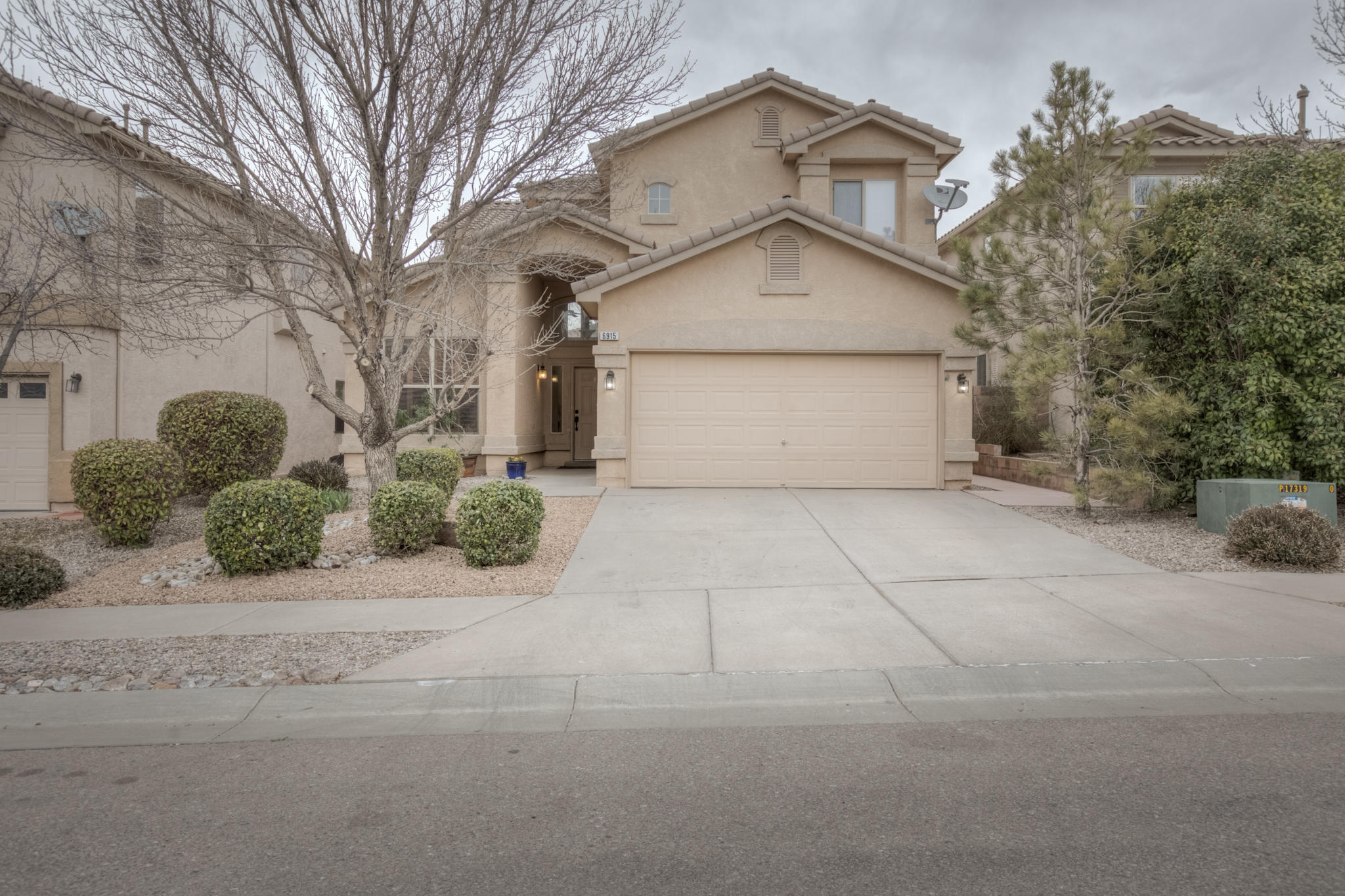 Beautiful, light-filled home in NE ABQ , with convenient access to shopping, dining, parks, and the freeway, located in the La Cueva High School district. Main living area features high ceilings, fireplace, and built-in bookcase. Spacious kitchen w/ quartz countertops and extra deep Blanco Diamond undermount sink (both installed in 2020), gas range and cozy breakfast nook. Large master bedroom on main level w/ master bath with double sinks, garden tub, separate shower, walk in closet and water closet.  Upstairs loft for additional living or office space.  Luxury vinyl in downstairs living area and master bedroom installed in 2020. New refrigerated air unit installed in 2018.  Plantaton shutters on main level.  Backyard features a patio and pergola and easy-care turf.