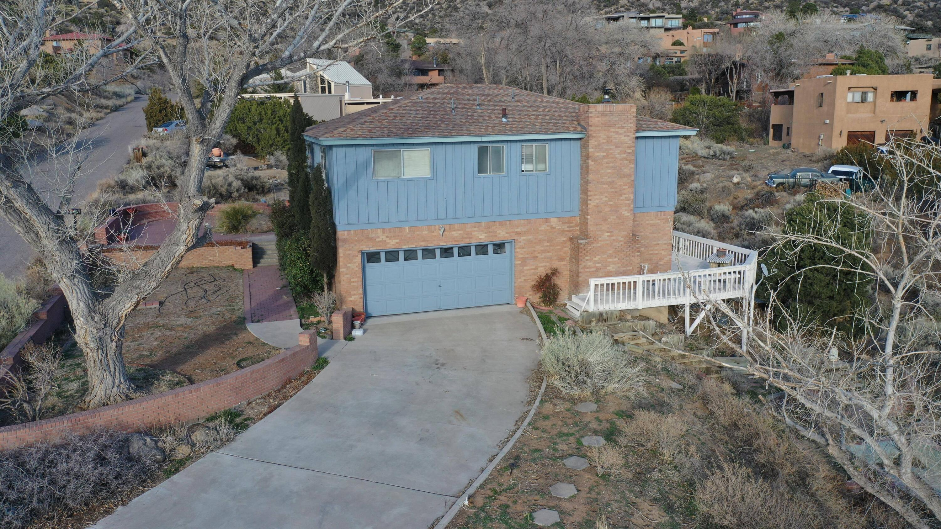 This custom 4 bedroom, 2 1/2 bath, tri-level property sits in the beautiful Sandia Heights subdivision located at the base of the Sandia mountains! The property has a great location with gorgeous views of the Sandias and the city. Enjoy these views from the 600 sq ft wrap around deck. The unfinished 700 sq ft basement offers potential for a bonus room! The septic system and roof have been replaced in the last 10 years! This home is ready for a new owner to capitalize on it's potential!View this home via Matterport Mapping and Aerial Video!