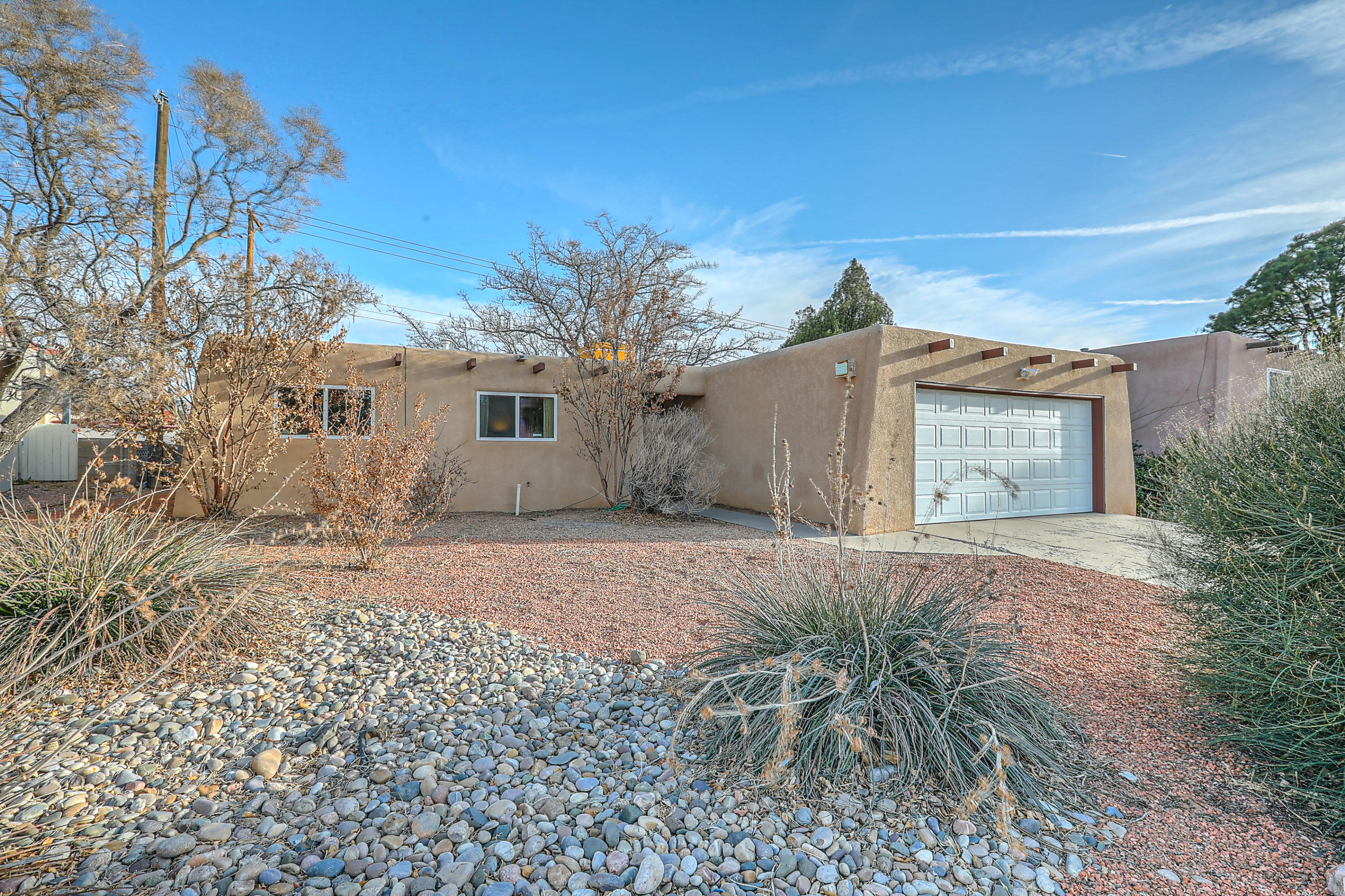 Welcome to this magnificent charmer! Mountain views from the backyard!  Many updates, and to mention just a few: Interior paint, water heater, remodeled baths, Silicone roof, Mastercool , kitchen counter tops and the list continues! Gorgeous wood floors in living/kitchen spaces, 1 yr old carpeting in the bedrooms!  Its just a beauty that you will not want to miss!