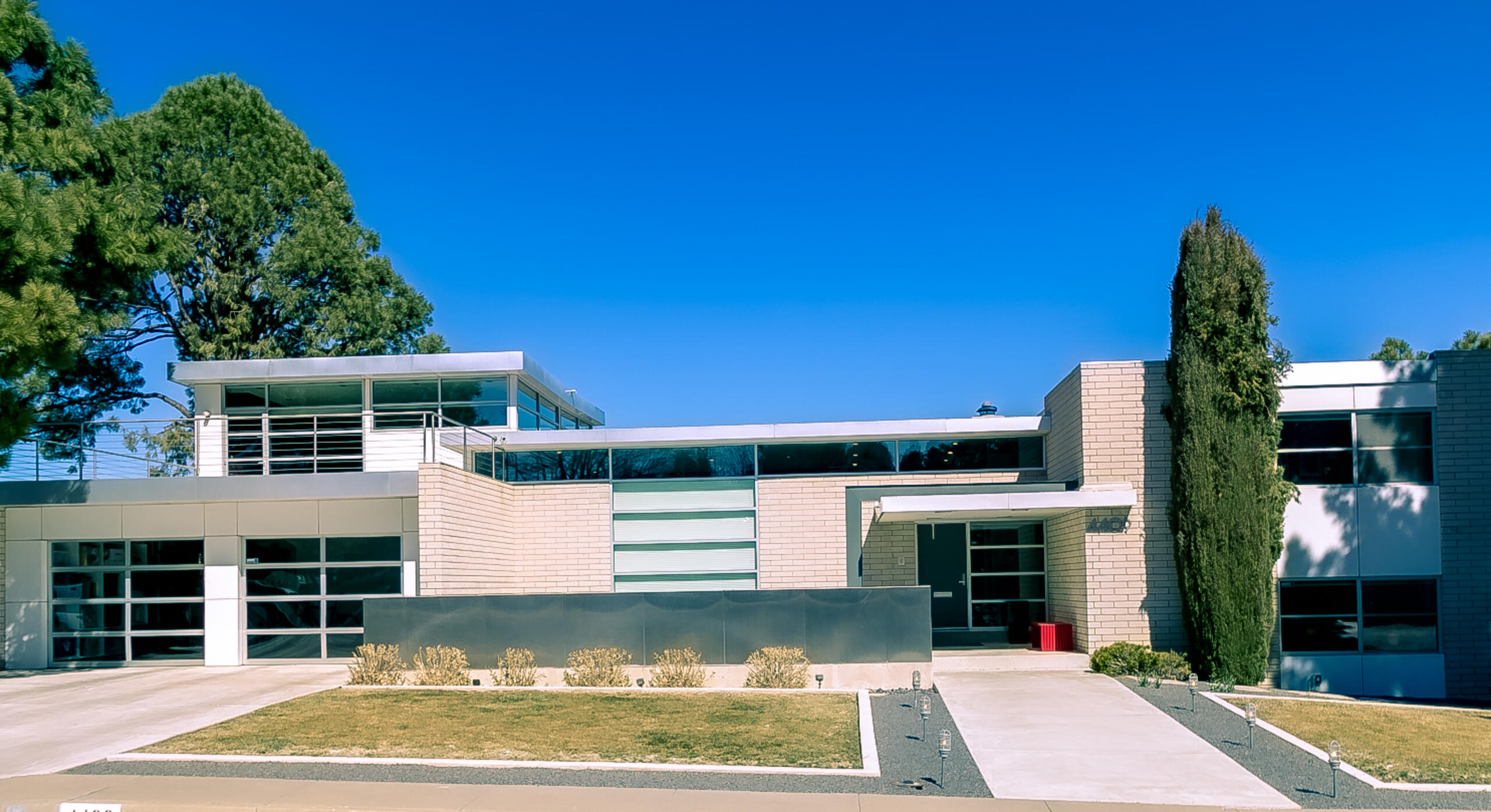 A mid-century contemporary home of enormous style and distinction in Altura Park, 4409 Chinlee Ave NE offers both an outstanding mid-city location and exceptional design. Originally constructed in 1963 by Mossman then brilliantly re-imagined by noted local architect Jon Anderson. Three living areas, open kitchen with breakfast nook, four bedrooms each with en suite bath and walk-in closet, plus upper-level rec room with butterfly ceiling and roof deck offering incredible mountain views. An expansive covered patio with fireplace and outdoor kitchen, green lawns, azure pool, hot spa and pool house allow for the zenith in outdoor living. This, truly, is an incomparable, breathtaking residential experience.