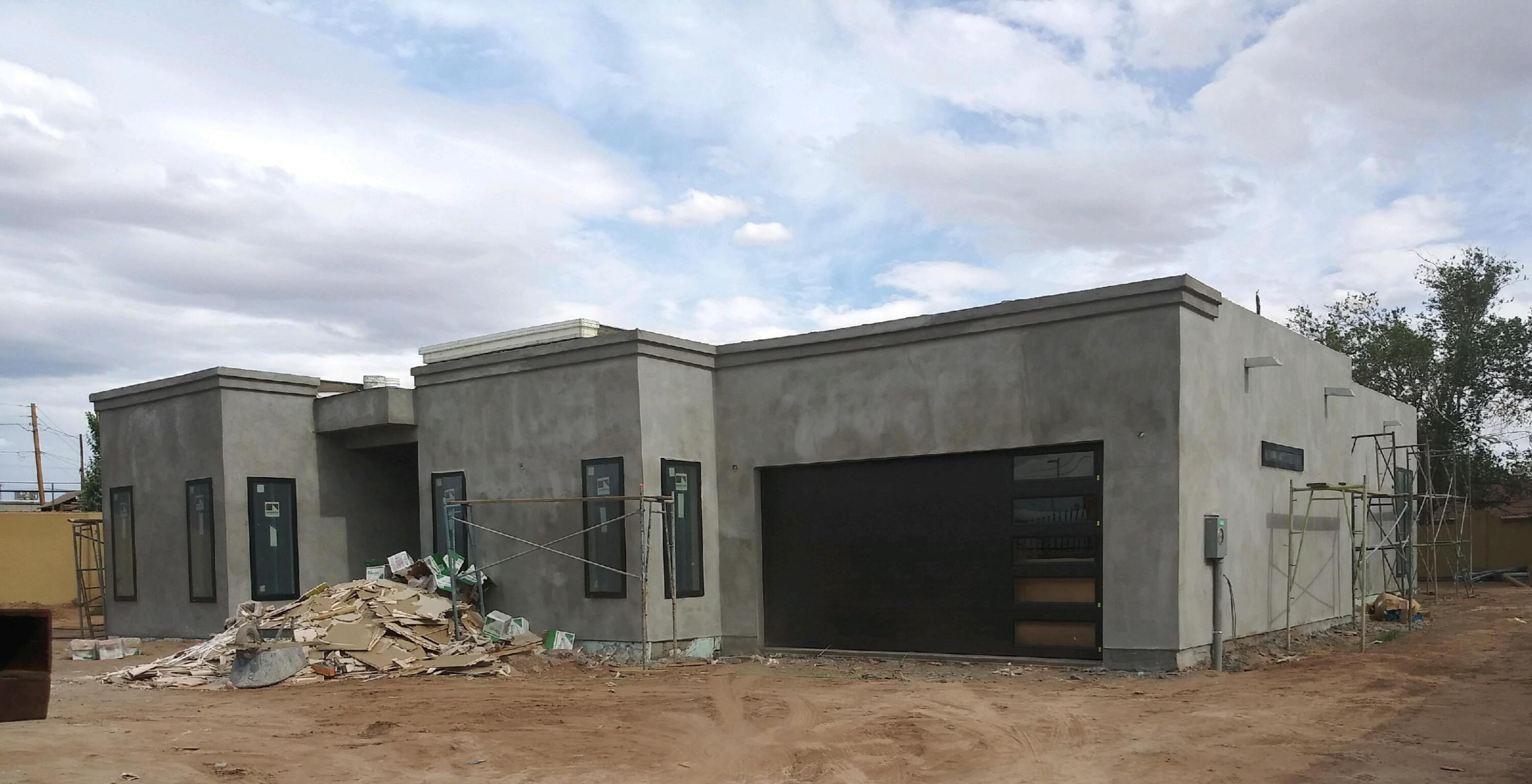 Under construction for early May 2021 completion. Pics coming soon. Buy now and make the south Valley your new home.  A rare find indeed - affordable, new homes in Albuquerque. Loaded w/amenities incl linear fireplace, Stainless appliance  pkg  & convection oven + micro , SS DW, SxS refrig, Tile in entry, kitchen, laundry, dining, baths, family and hall. Garage has extra storage area and garage door opener. , Front landscaping, LED lighting, oversize kitchen sink. Master has dual vanities, freestanding tub + separate shower, large walk in closet. Handicap accessible shower.12' ceilings in the kitchen and living room w/furrdowns . This home has it all.  on 1/3 of an acer. Back Yard access.Set up your appointments before it is sold.