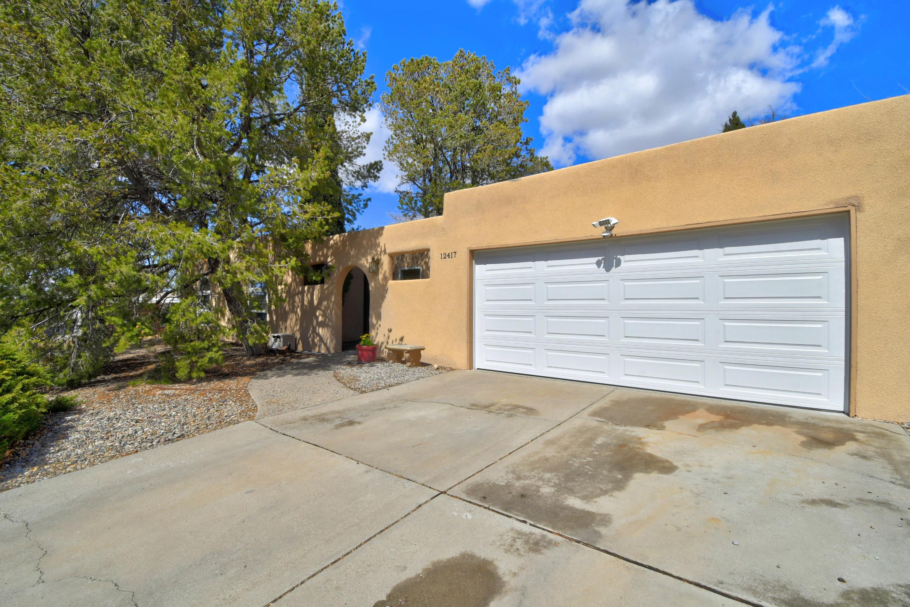 This is it! Very well maintained, 1 story home in NE ABQ.  This 4 bedroom, 2 bathroom home is situated on an established street near Tramway and Menual. The front patio welcomes you into the extremely cozy home! Each room is very spacious and private.  The master bedroom has its own access to the beautiful back covered patio. The kitchen opening to the living area (complete with kiva fireplace) is definitely a huge feature. The large backyard is big enough for any type of gathering. Make your appointment today to see this excellent home in an excellent area!