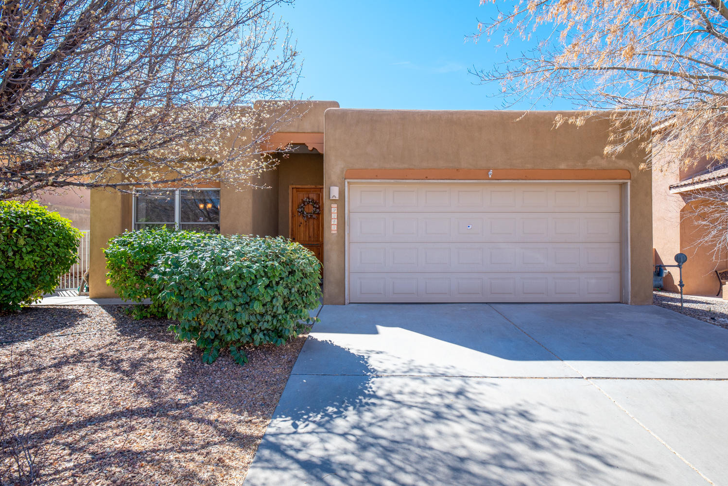 You will not want to miss this charming home in La Cueva school district! Great room with Vigas ceiling, gas fireplace, granite counter tops, stainless steel appliances, large master bedroom, 20' raised ceiling.  Come and see it today.