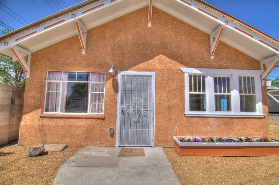 Come and feast your senses in this quaint vintage house equipped with a modern-edgy twist. Originally built in the 1920's in the historic Cesar Chavez neighborhood, this house is nestled right in the middle of a rapidly growing community! Just a short drive away from ABQ downtown, UNM main campus, CNM main campus, UNM hospital, Presbyterial Hospital, Lovelace Hospital, and a minute from I-25.Amenities of this beautiful property include:-A 2-car carport.-Enclosing coyote fence with a beautiful steel gate.-Grass, a drip system, xeriscape.-Hardwood floors.-Hot Water Recirculator for instant hot water.-A brand new Master Cool AC unit with Upducts accessories for efficient cooling & fan to push hot air out of the attic. Furnace works extremely well.This house has
