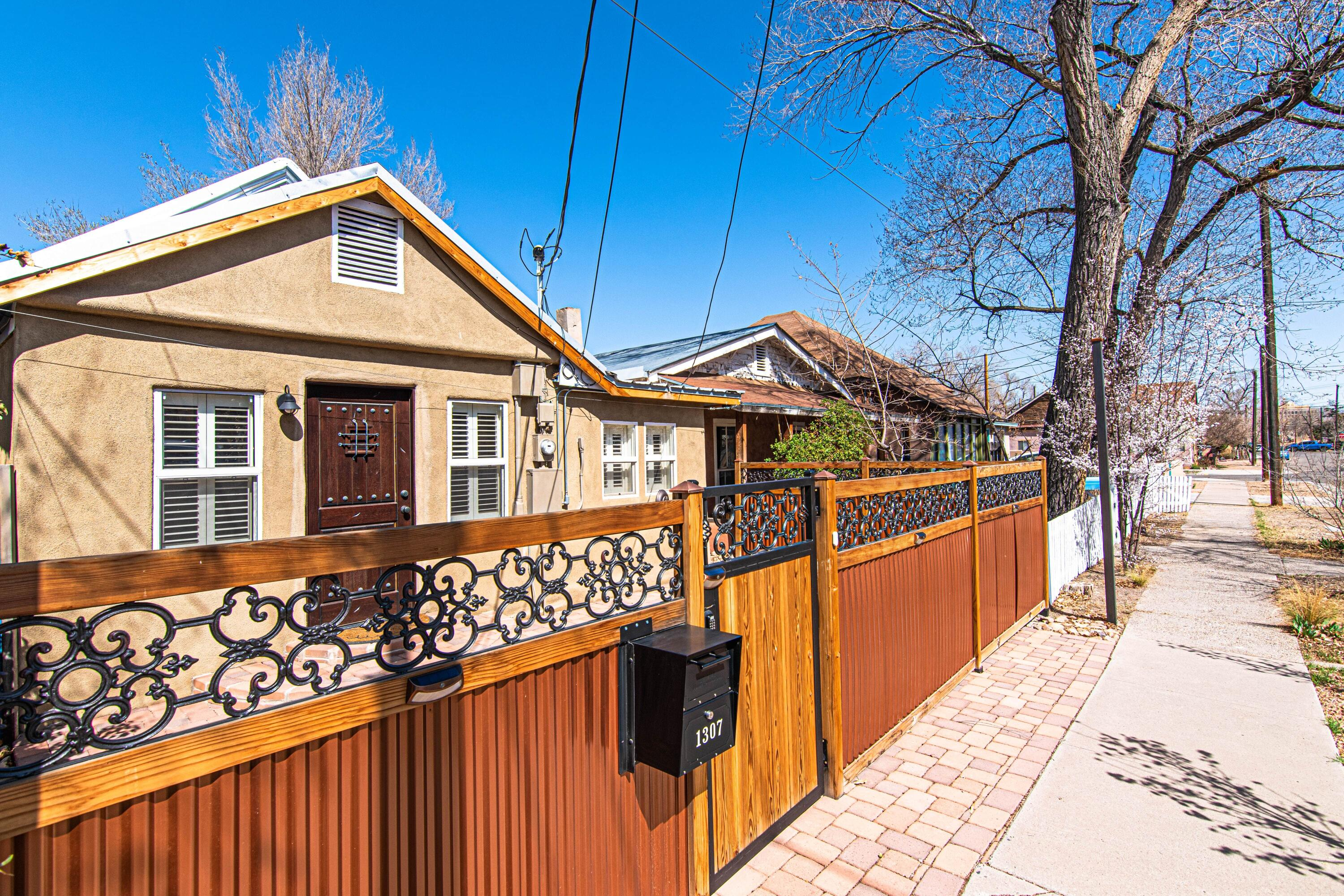 In a market where properties sell in mere hours, rush out to check out this desirable downtown 1930s home that is within walking distance to Old Town and the Sawmill District.  This picturesque two-bedroom dwelling has upgraded refrigerated air and furnace (2020), newer water heater (2018), newer stucco (2018) updated waterproof flooring, fresh paint (2021) and custom cabinetry (2018) in the foyer & master bedroom.  Improvements are finished off with new barn-style doors (2020), new exterior doors and wall-to-wall front yard landscaping.  The home is on an extended lot with backyard access and I-40 is less than one-mile away.  Repairs being completed. As-Is.
