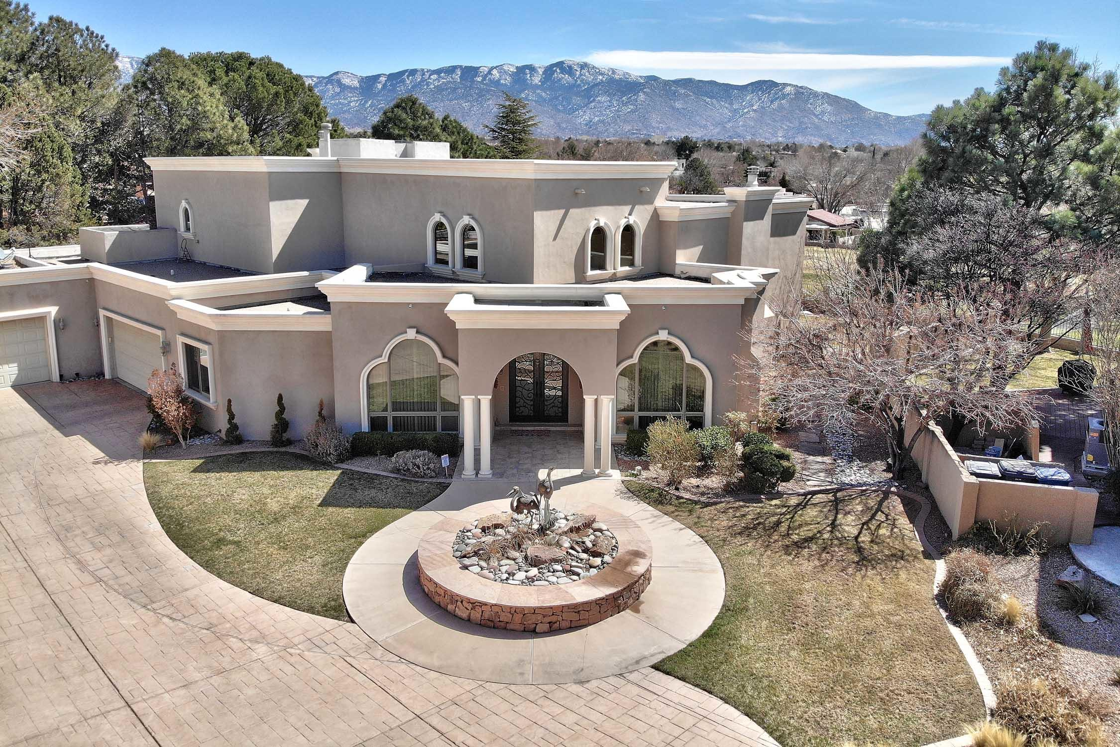 Dramatic price adjustment!! Live your dream...in this extraordinarily beautiful, luxury home!  Quality built. Tanoan Golf course lot  with views of mountains, golf course ! Some of the exceptional features ... elevator to upper bedrooms, Cantera custom entry doors, 22ft ceilings, all walls are diamond plaster, Movie room with 180 inch screen, stunning master (opens to wrap around balcony) with  19x19  closet , spa like bath and fireplace. Italian travertine floors, wet bar down and morning bar up,.  Amazing kitchen wit Sub Zero ref. and separate freezer, 6 burner, plus grill, Wolf range and double ovens, granite counter tops and custom cabinets.  Large inground pool with auto safety cover and inground spa. 4 car garage with built in  closets, new security system w/8 cameras...see ''mor
