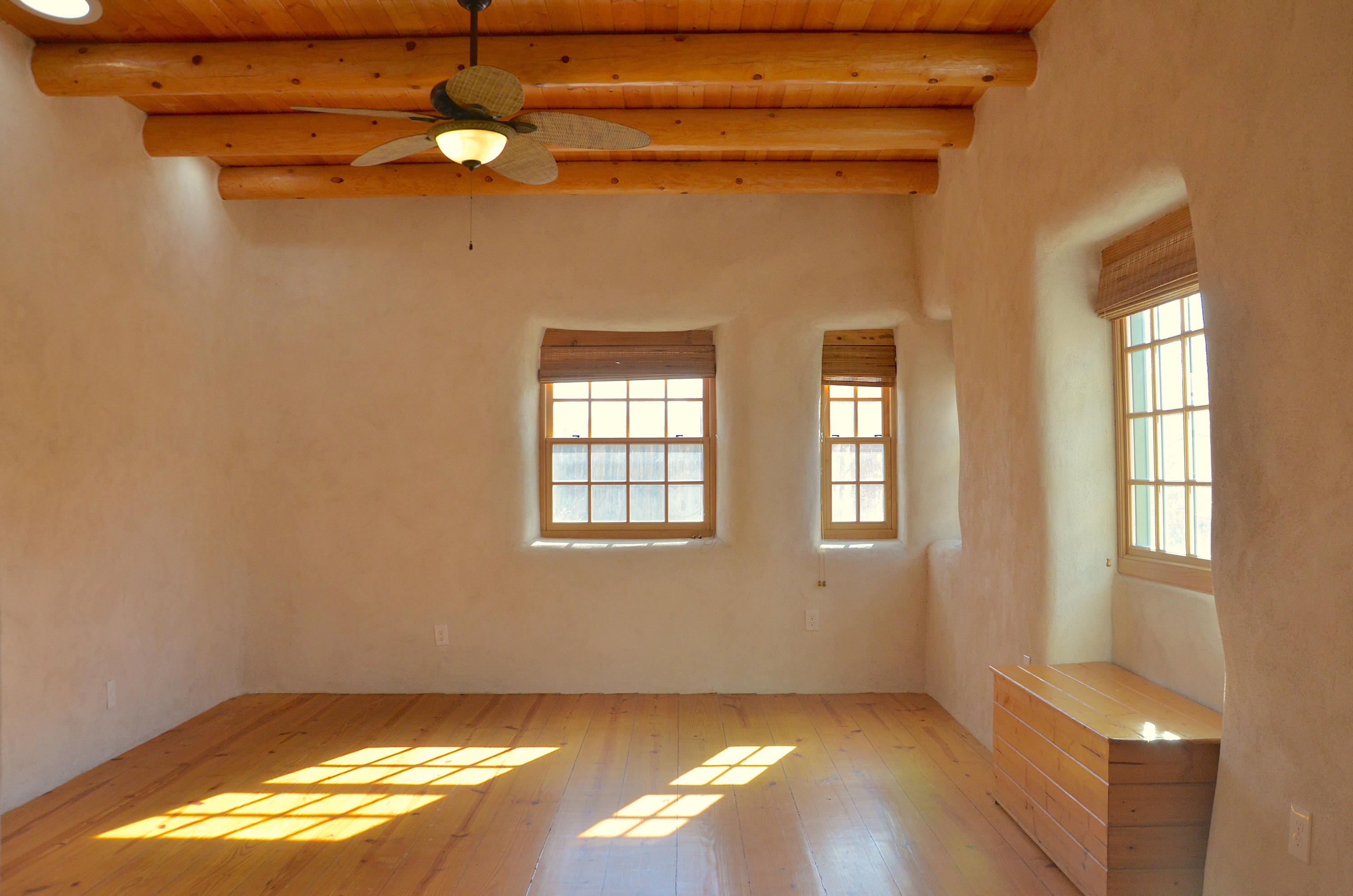 2 ADOBE HOMES in THE SAWMILL DISTRICT!  A great opportunity to purchase 2 homes in 1 large corner lot. Lots of possibilities! NORTH HOUSE: Built by adobe builder Alberto Parra c.1950's and enhanced with a straw bale addition by Cadmon Whitty in 2015. This one bedroom, 1 bath, 996 sf. charmer features vigas and latillas, high ceilings, skylights, 2 kiva fireplaces, beautiful brick and hardwood floors. The eat-in kitchen is adjacent to an interior space with plenty of built-in storage. SOUTH HOUSE: This larger 3 bedroom, 1 bath,1,068 sq.ft. home features a wood burning fireplace, updated windows and plenty of natural light. The large eat-in kitchen and laundry-utility room have plenty of storage. NEW TPO roof, paint, carpet, parkway landscaping and off-street parking in a fully fenced yard.