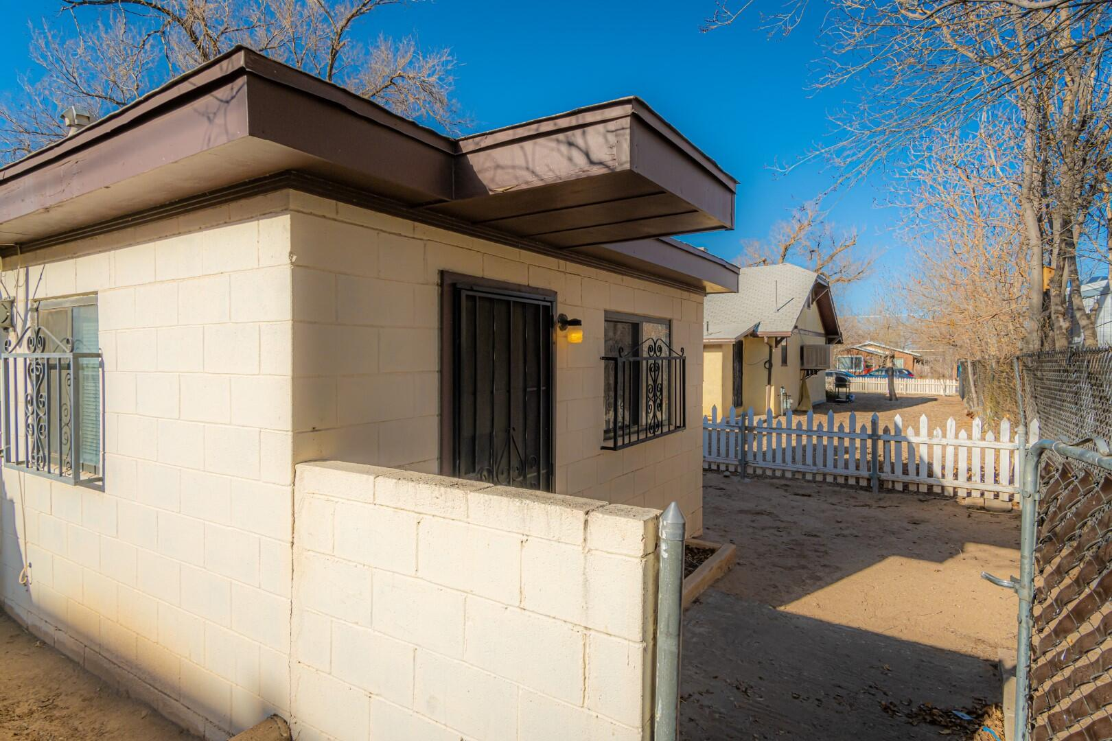 Incredible property steps away from UNM.  Main house has 860 sq ft,  2 stories with 1 bedroom & .75 bath upstairs and 1 bedroom with full bath downstairs, kitchen & living room. Casita is 528 sq ft & has own access with 1 bedroom and .75 bath,  kitchen, living room & washer/dryer hook up, 6 yr old wall furnace.  Front & back yard privacy.  1-car garage.  990 ft parking with 3-car parking permit.  Current Lease Agreement expires September 30, 2021.