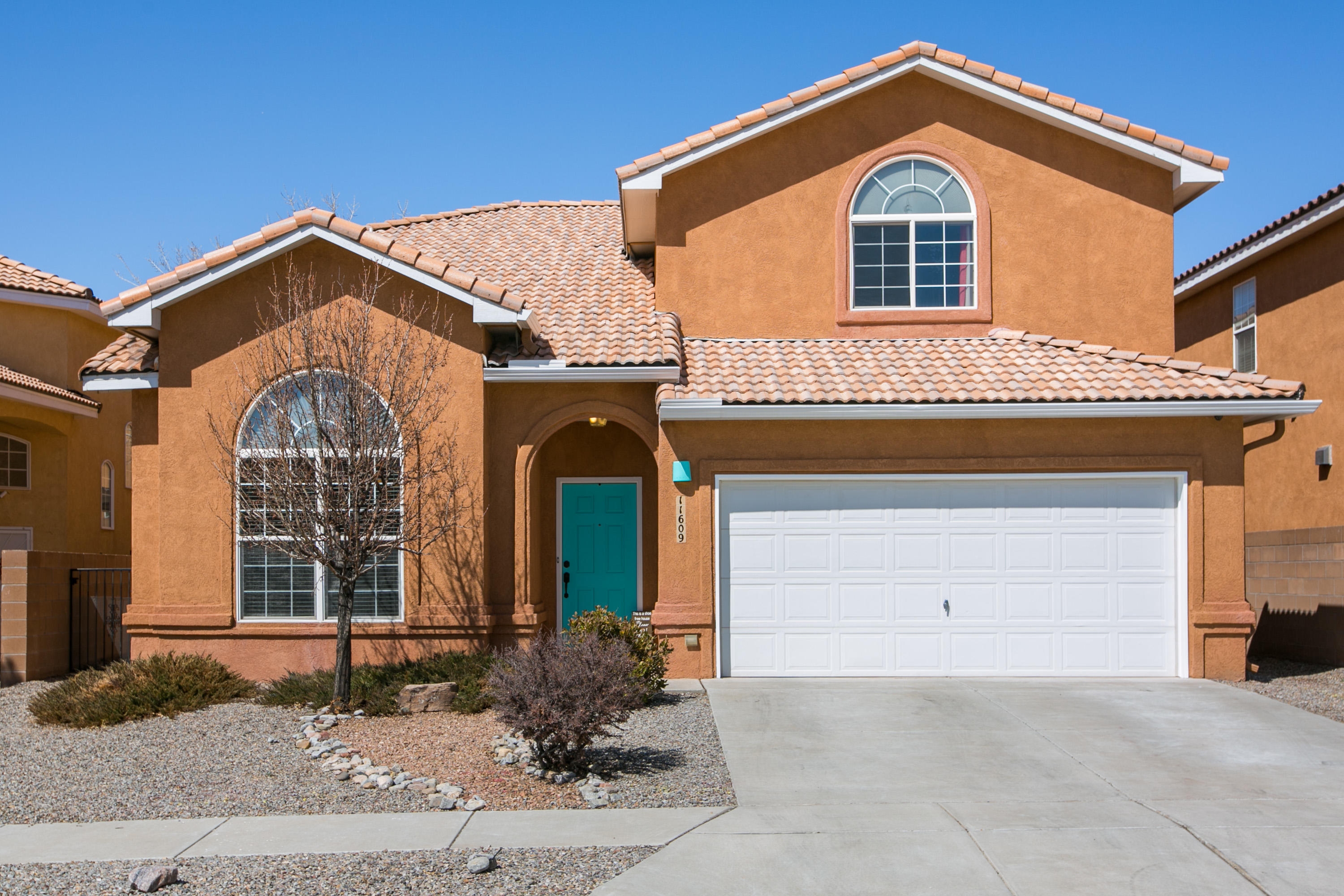 Wonderful open, light bright family/extended family home. NO PID! NO PID!NO PID! Situated close to Air Force Base & Sandia Labs.Downstairs bedrm has direct access to a 3/4 bathroom. Possibly 2nd master. Vaulted ceilings in the entry & living. Master has onsuite w/ garden tub & shower & 2 sinks, walk-in closet. Large closets in 3 additional bedrooms upstairs & fans in all bedrooms. Home has new trim throughout, with new luxury vinyl plank floors installed on the main floor, as well as the 2 bathrooms upstairs. Home has 2 living areas & formal dining. New Paint, newer appliances including a gas stove. Complete Landscaped yard has an irrigation system. Covered Patio & Upstairs deck off Master.  Across the street from a Green Belt for walking, riding bikes & playing catch.Make sure you see