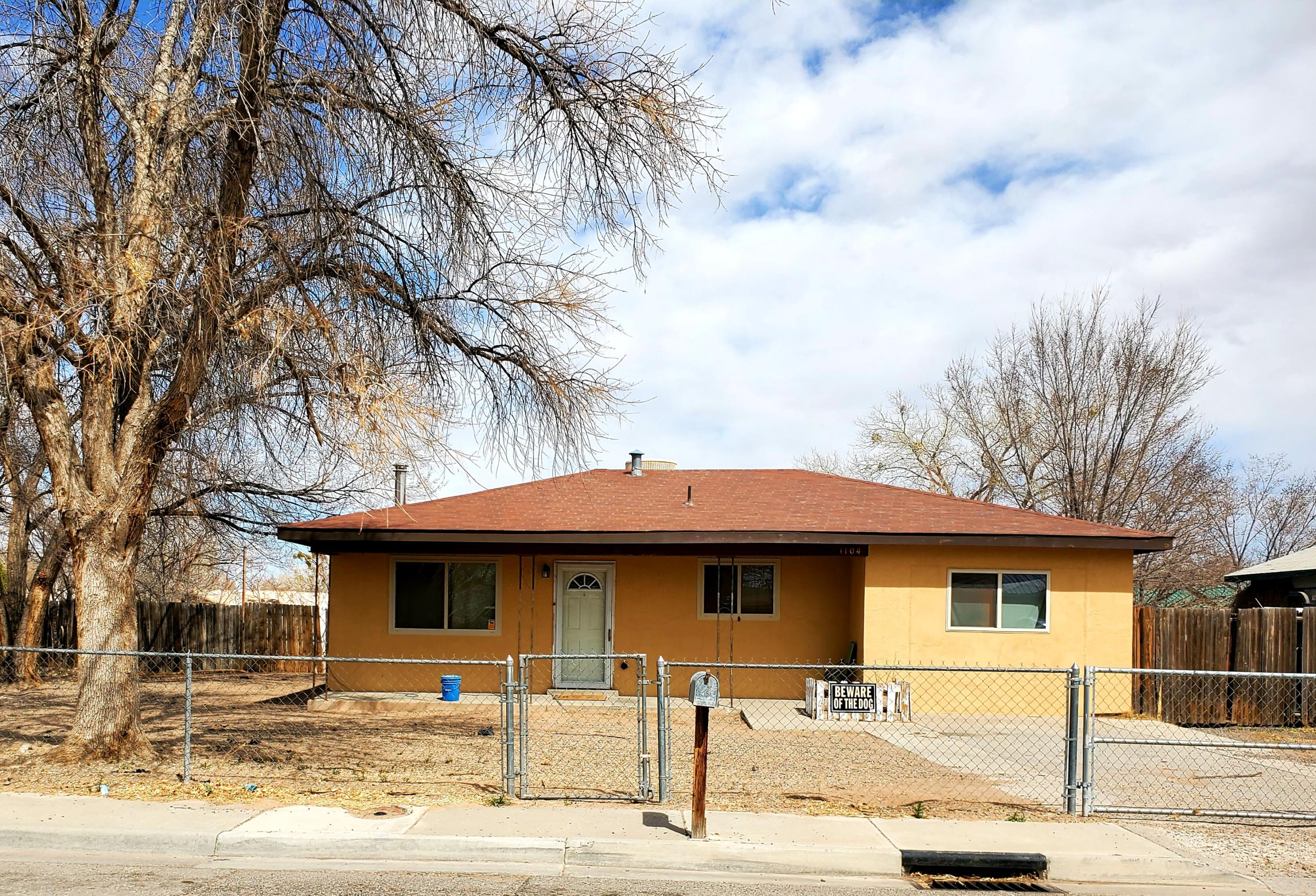 Great four bedroom home on a large, fully fenced, corner lot in the center of Los Lunas offers an updated master bathroom and windows, large utility room, covered patio and backyard access.