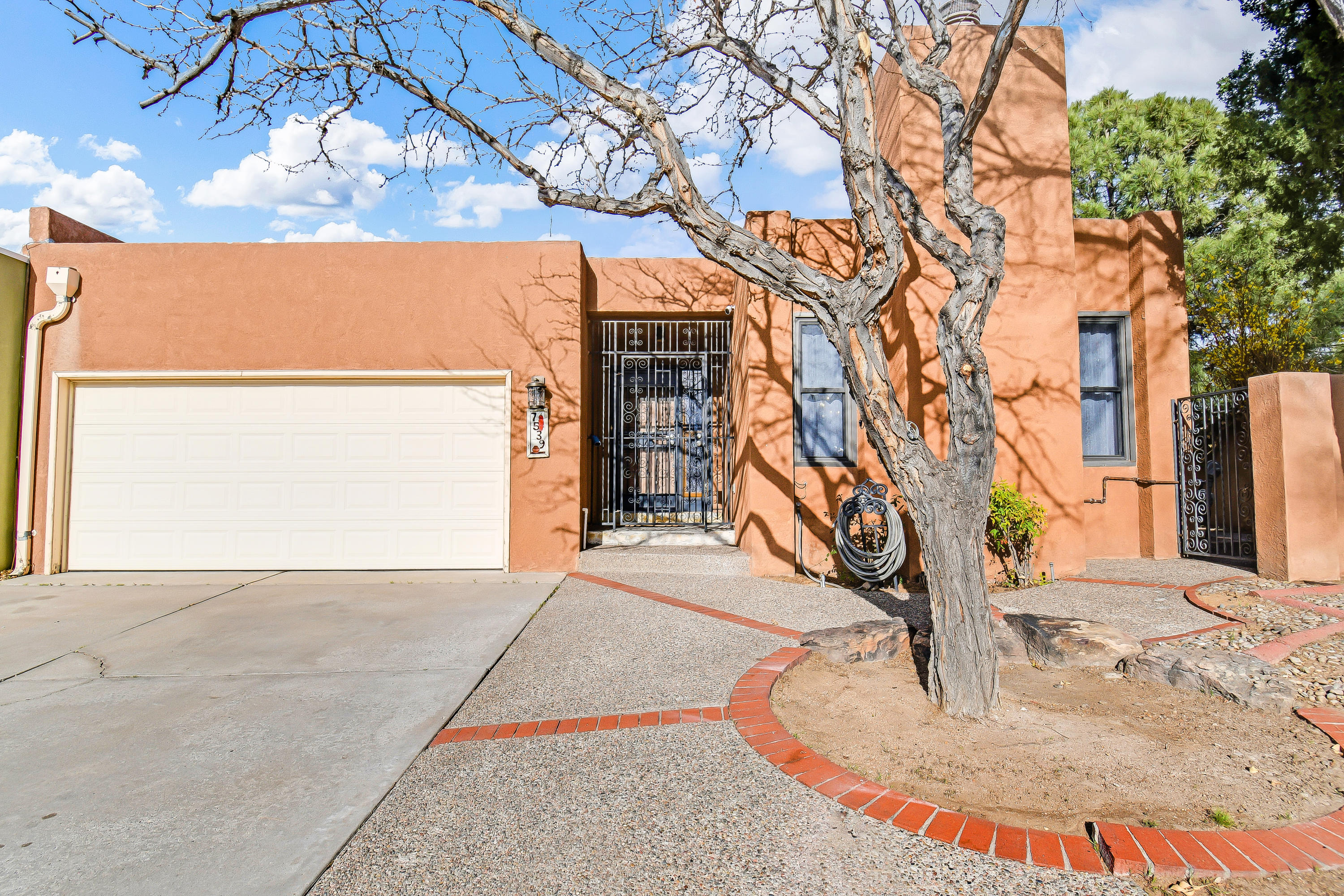 Lovely NorthEast townhome for sale!  Nicely remodeled and ready for a new owner! Location is key, and this gem is right off Wyoming & Academy.  Easy access to Paseo and the Interstates, and is in Sandia High School district.  3 big bedrooms, high ceilings throughout, and 1.75 baths! New kitchen cabinets, quartz countertops, and butcher block accents make the kitchen a fabulous place to cook, and entertain.  Wine fridge, and newer kitchen appliances stay! Lighting in the home is classy, and all new! Green courtyard is perfect place for morning coffee or evening wine! Views of the Sandias should not be overlooked while visiting.  This won't last long, so get your showing set!  All offers to be reviewed Monday morning, March 29th.