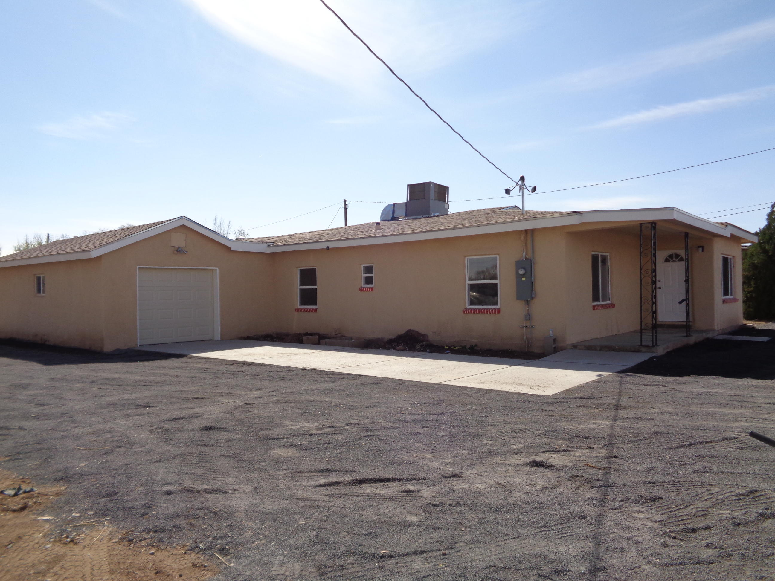 This Fantabulous Adobe House has been remodeled and ready for a quick closing!  It has 3 bedrooms plus an office.  Formal dining room between living room and kitchen.  All appliances convey.  Split master suite with roll-in shower.  12 x 26 garage.  Situated on 3.18 acres adjacent to the Tome Acequia--easy access to irrigate!