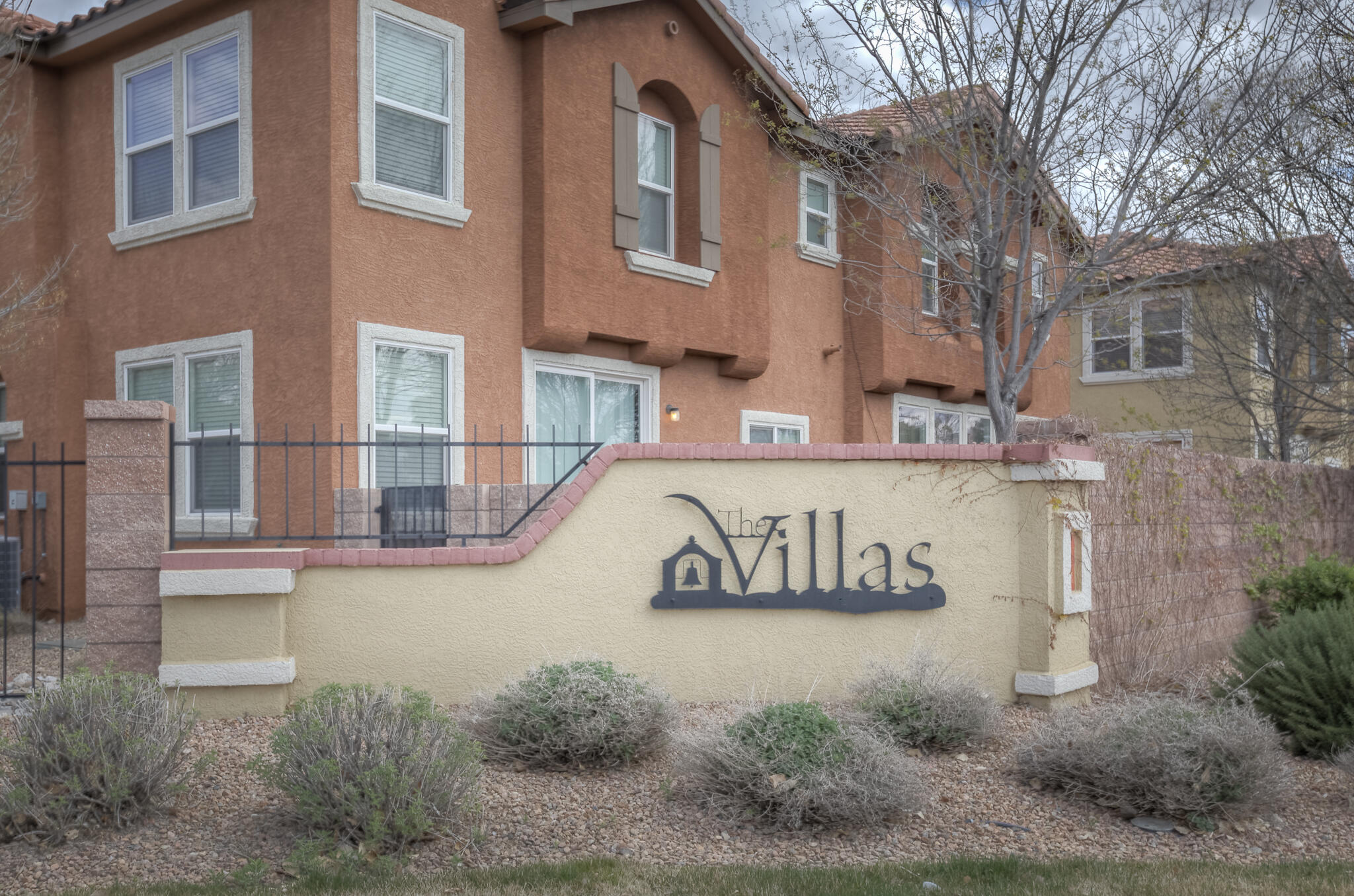 NO SHOWINGS UNTIL APRIL 2nd. Updated Townhome centrally located in The Villas gated community. Close proximity to UNM, Hospitals, Downtown and many more amenities. Open floor plan with updated Stainless appliances, granite counters, cabinets, laminate wood flooring, central vacuum, tankless water heater, refrigerated AC and private patio.  Master bedroom has large walk-in closet and double vanity. The Villas HOA maintains entry gate security, building exteriors, landscaped common areas & playgrounds and community pool & club house.
