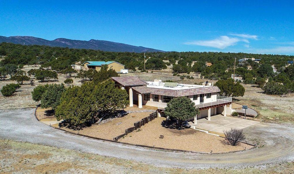 Property Overview - Looking for quiet living, lots of space (5 Acres) on the outskirts of Albuquerque, this is the home for you. Only minutes to town. Many updates: Most recently new gas cooktop, wood floors in the hallway, family room, foyer, and all bedrooms, new oven, new oven and counter in downstairs kitchen, new septic system. Past updates include TPO Roof (2012), Water Softener (2014), Stucco and windows. Private entrance to In-Law Quarters Approximately 1775 Sq Ft of living area with Kitchenette, Fireplace, Bedroom has full bath. Room downstairs could be converted back to a second laundry room. This wonderful 4/5 Bed, 4 Bath, 3 Liv Area has abundance of storage. Enjoy the great views of the South Mountains and magnificent Sunrises and Sunsets Wrap-around deck.