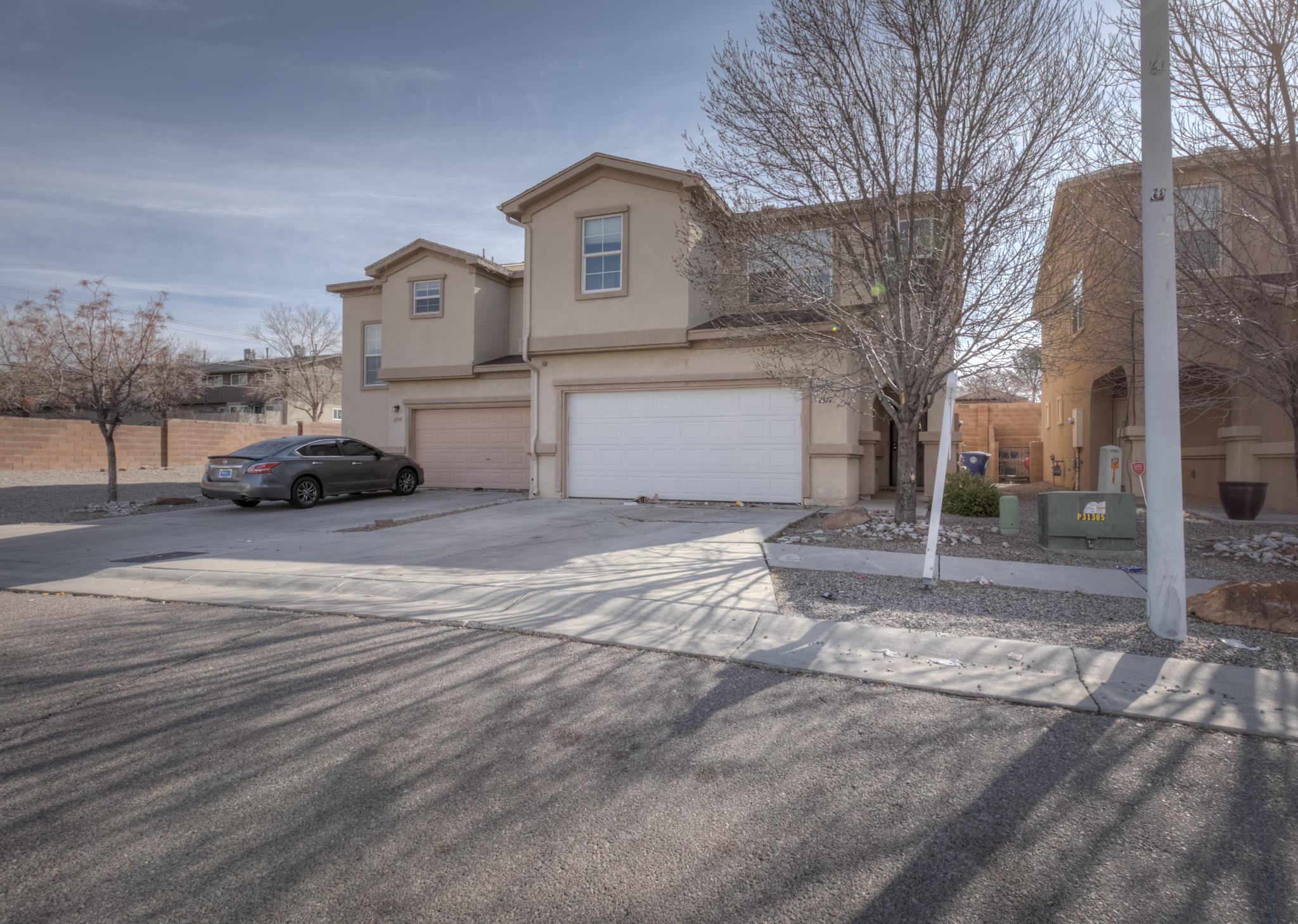 This Beautiful spacious townhome is located near UNM, the Airport & the freeway with easy access to anywhere in Albuquerque. The master bedroom is bright and is open to the spacious bathroom with plenty of room for two people. This Home has two living areas, one upstairs and one downstairs. The open floor plan creates a inclusive atmosphere whether your are cooking or just hanging out in the living room. The front and backyards are easy to maintain for the busy professional. Come live the Urban life in Albuquerque.