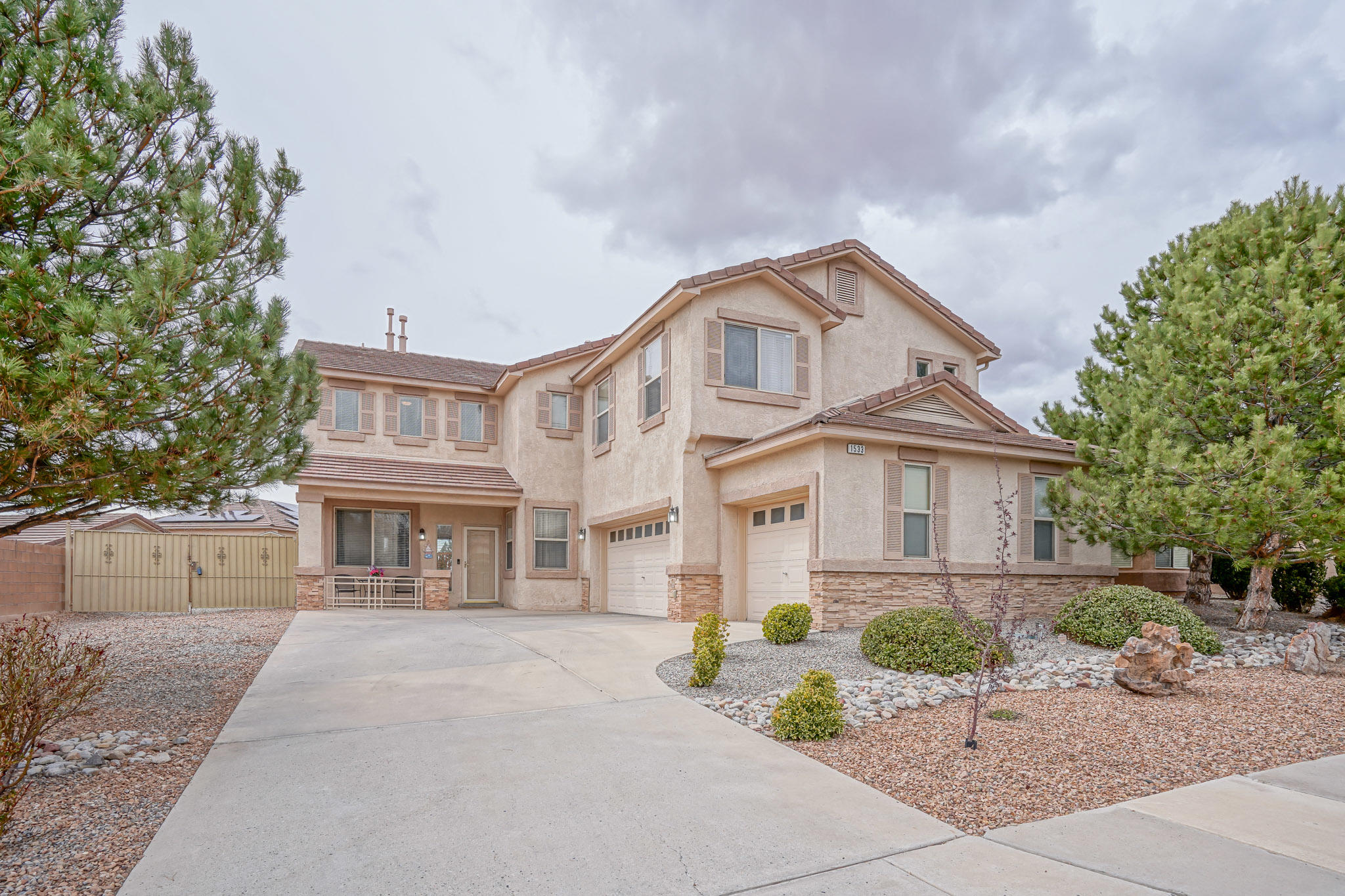 Nestled in the Cabezon Neighborhood in Rio Rancho, this desirable DR Horton home is one that you don't want to miss out on. This home offers a spacious, open floor plan that is flooded with natural light from the huge living room windows. Featuring: 4 bedrooms, 3 bathrooms, a large loft, and a three-car garage, providing plenty of space to grow and expand your life. The kitchen offers granite countertops, a double oven, and an island for your guests to gather around. The great room pulls you in, and you'll love gathering around the log fireplace when the weather gets cooler. An oversized master bedroom is a perfect place to relax and enjoy your jetted tub! Outside, you'll find your personal oasis with an extended covered patio and an above-ground pool with raised pool deck. Come see today!