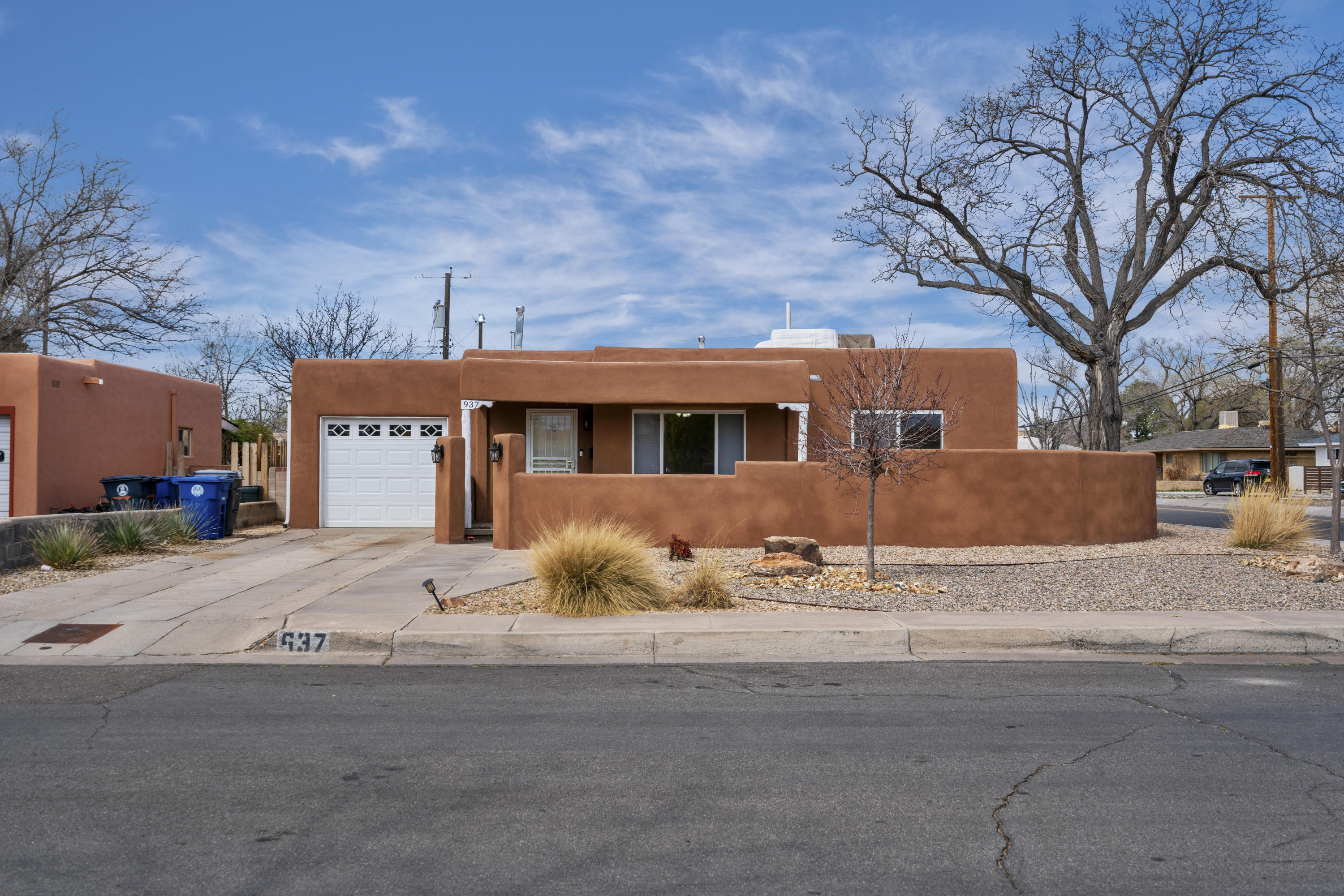 4 Bedroom 2 Bath 1 story large corner lot with alley access. Hardwood Floors, New TPO Roof 2019, New Stucco 2016, Fully landscaped with New Sprinkler system 2016.Updated vinyl windows. Courtyard view of the Sandia's. Professionally  maintained home.