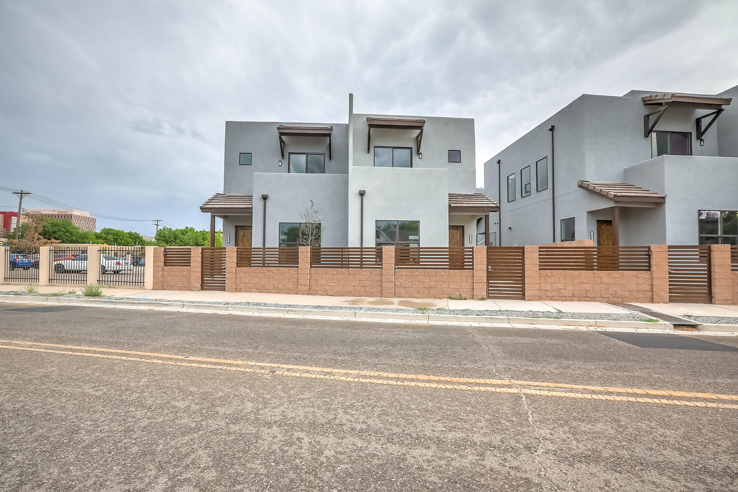Ibiza Townhomes! Brand New Custom Built Two Story Townhomes, located in the trendy downtown ABQ! Location, Location, Location! These amazing homes are built with custom flooring, tall ceilings, full overlay cabinetry and granite counter tops. The 3 bedroom design includes two full bathroom, plus a 1/2 bath for guests. Custom touches in every bathroom like tub to ceiling 3-D style tile, furniture style vanities and tankless water heaters, plus AC combo units for you hot and cold needs. Enjoy the large finished double car garage with plenty of parking on the oversized drive pad..