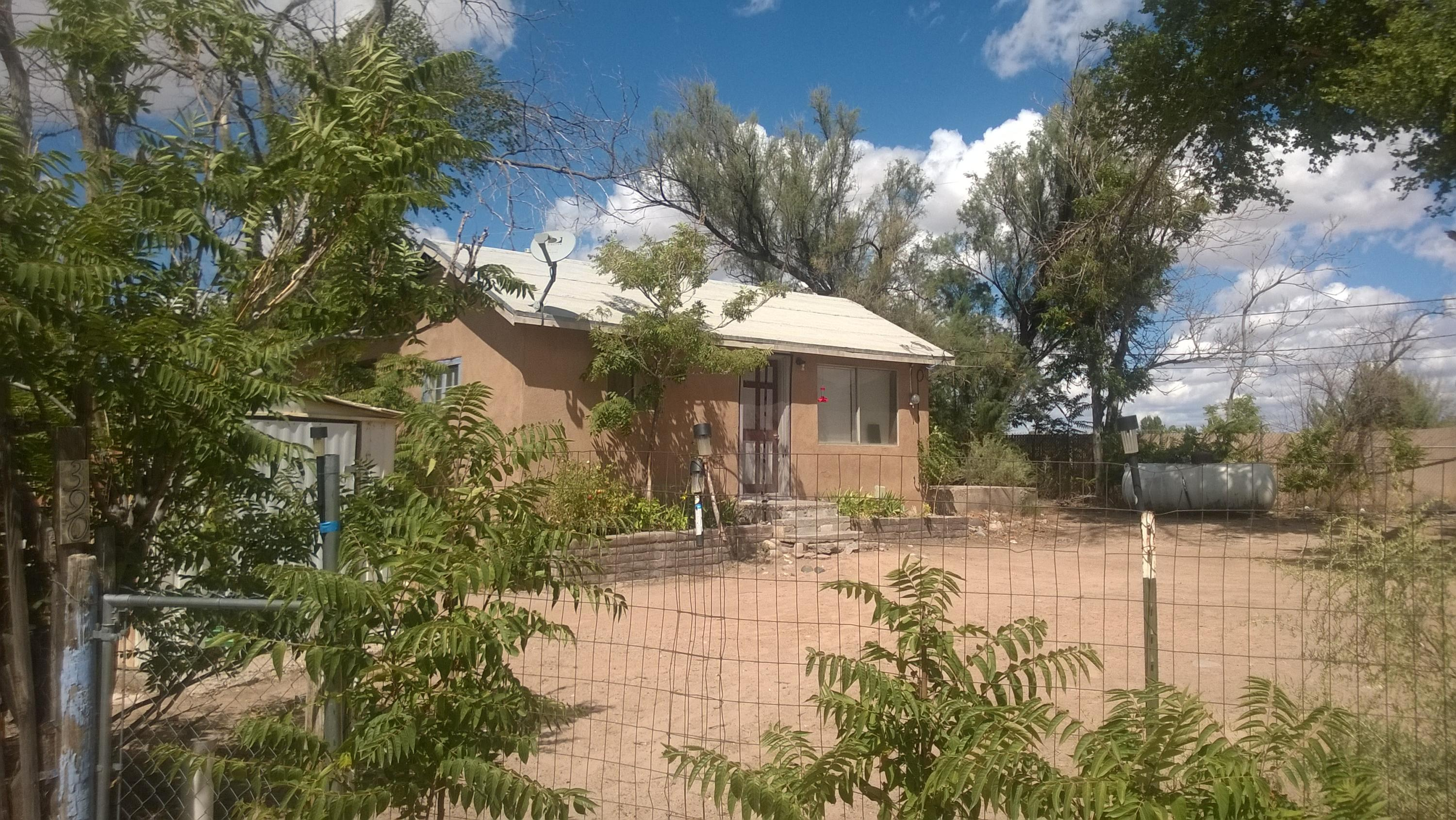 Corrales Property under $200K... Handy Person Special... Fixer Upper... Property has one home and on mobile home with an addition.  Both Dwellings Need Substantial Work...