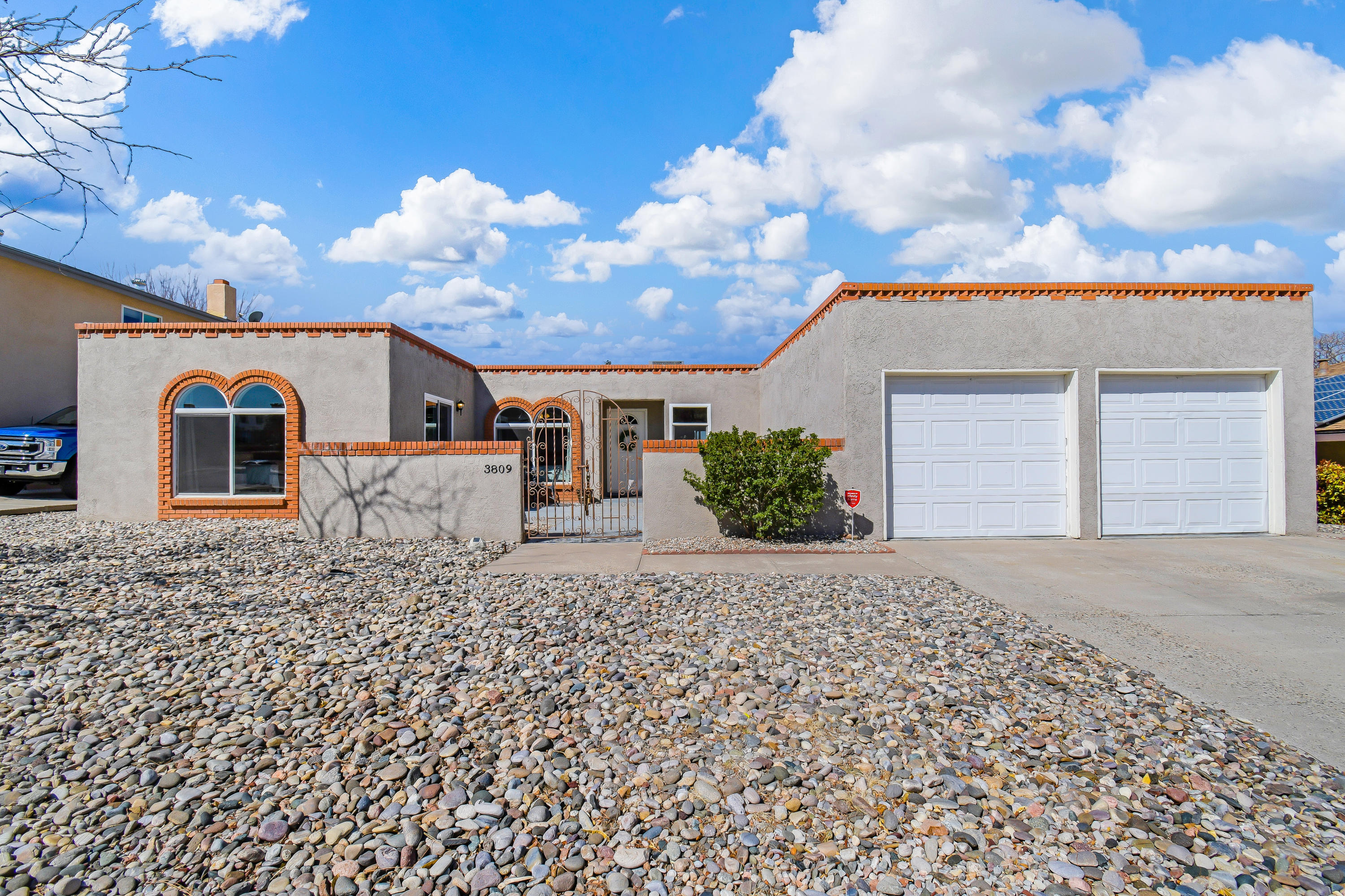 Beautifully remodeled 4 bedroom home in Sandia High school area.  Easy access to Wyoming and Montgomery.  Gorgeous kitchen opens up to two separate living spaces.  Sandia Mountain views out the front, and amazing sunsets to the back.  All mechanical features, including refrigerated air, from 2018.  TPO roof from 2018.