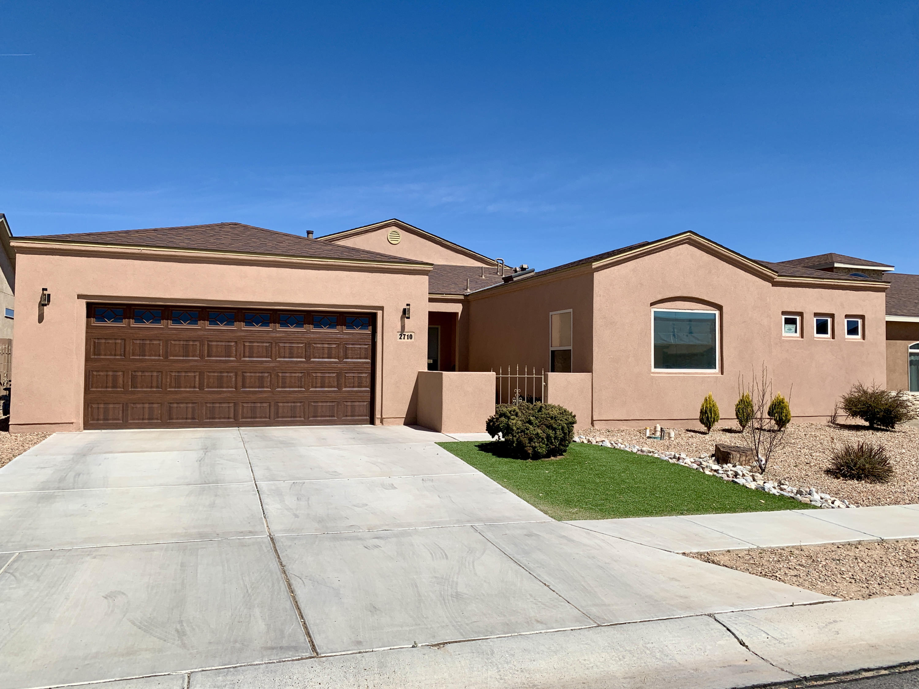 Open house canceled for 5/8!Gorgeous home located in the highly desired gated community in Huning Ranch with a large lot. The owners have kept this home in immaculate, like new, condition. New Dreamstyle stucco job with warranty. The remarkable kitchen offers custom cabinetry, hard surface countertops, a pantry, and large breakfast bar that opens up to the oversized living area and breakfast nook, making it a great home for entertaining.  The large living area won't disappoint with the plenty of ambient lighting, skylights, built in's for entertainment system, and surround sound.  The spacious master offers a coved ceiling, a private patio, separate garden tub & shower.  To top it off, enjoy the gorgeous NM weather in the backyard with an oversized patio slab.  Schedule your showing today!