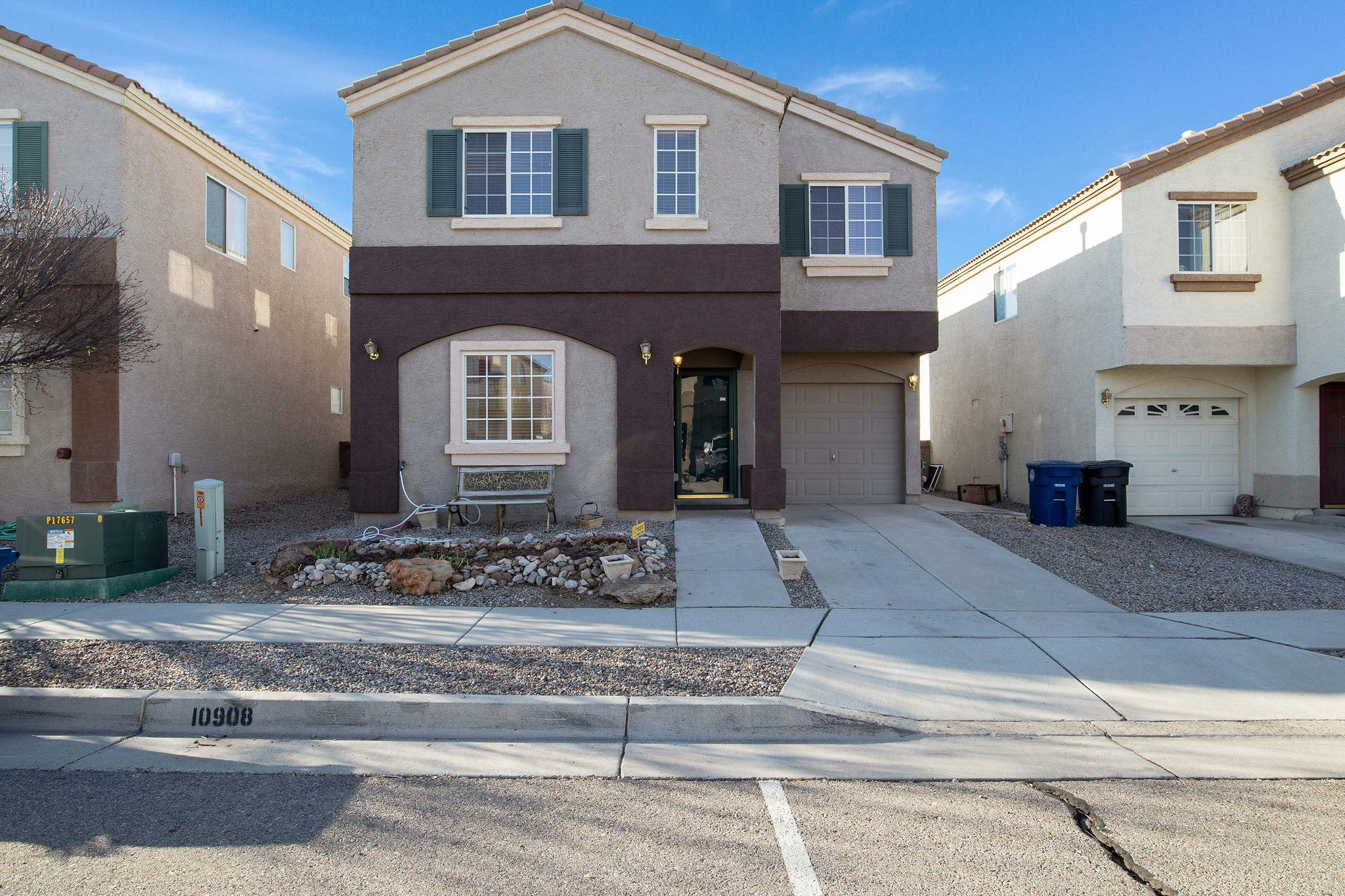 This impeccably maintained house home is located in a gated community minutes away from Kirtland Air Force Base, Sandia Labs, Costco, and Manzano Mesa Park.  The floor plan hard to find features including a downstairs bedroom, three full baths and two living areas.  The open concept kitchen has stainless appliances and a dining nook.  The upstairs primary suite is very large along with a private bath. Other features include a full laundry room, two car garage and easy low maintenance landscaping.