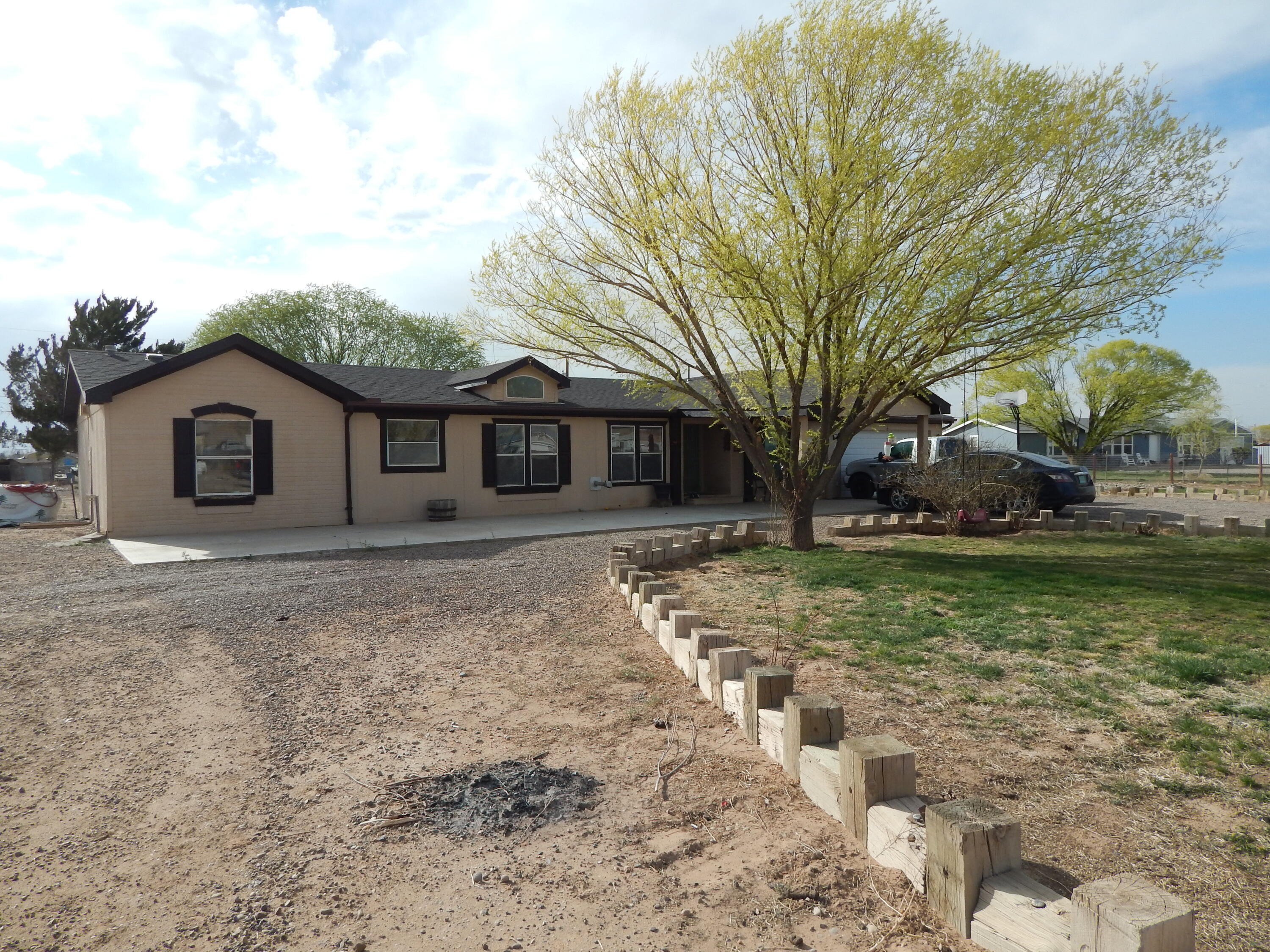 Lovely 3 bedroom, 2 bath doublewide on a completely fenced one acre lot.  Living room with cathedral ceilings & pellet stove. Spacious kitchen and family dining area. Split floorplan. New roof in 2018.  2-car attached garage. Mature trees with grass, covered front patio and mountain views!