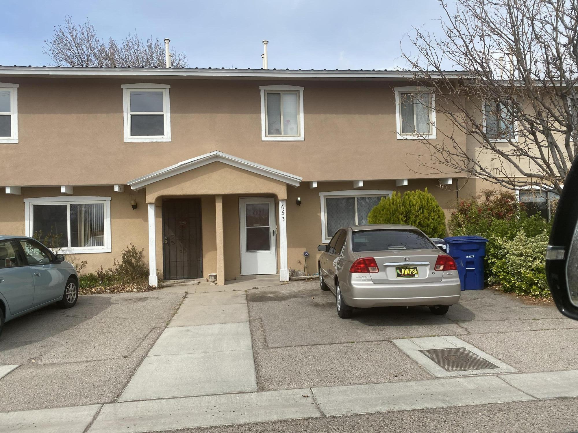 Great buy on this 3 bedroom townhome in Guadalupe Village.  Needs paint & carpet and updating overall.