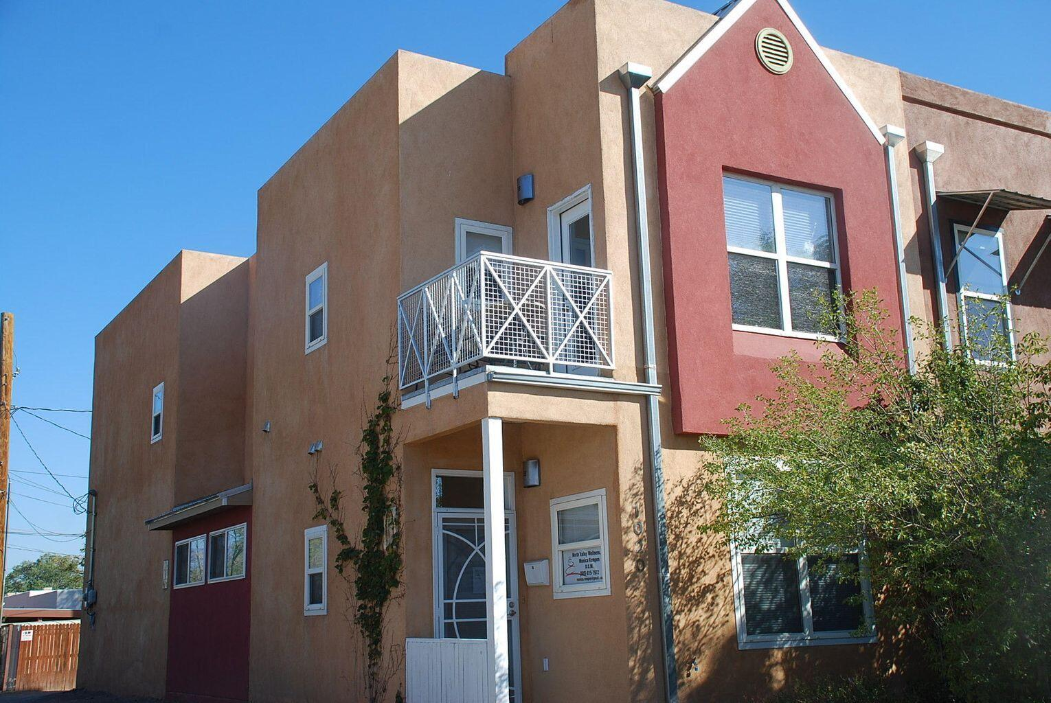 Priced below Appraisal! Fantastic reverse Floor Plan in this modern, bright, and well kept Townhome in a convenient location close to Downtown, Restaurants, Breweries, cultural attractions. 3 bedrooms, 2 1/2 baths, 1-car garage. Upper floor: Wood floors, Master Bedroom with Mountain views and walk-in closet, Kitchen has bar counter seating 3-4, 2 patios with city and mountain views. Ground floor stained concrete floors, office, 2 bedrooms. The Addition is 109 sf and unheated but can easily be incorporated to the adjacent Bedroom.  All Appliances included, the TV stays too. NO HOA. Zoned MX-L. Perfect home office, clinic, legal.