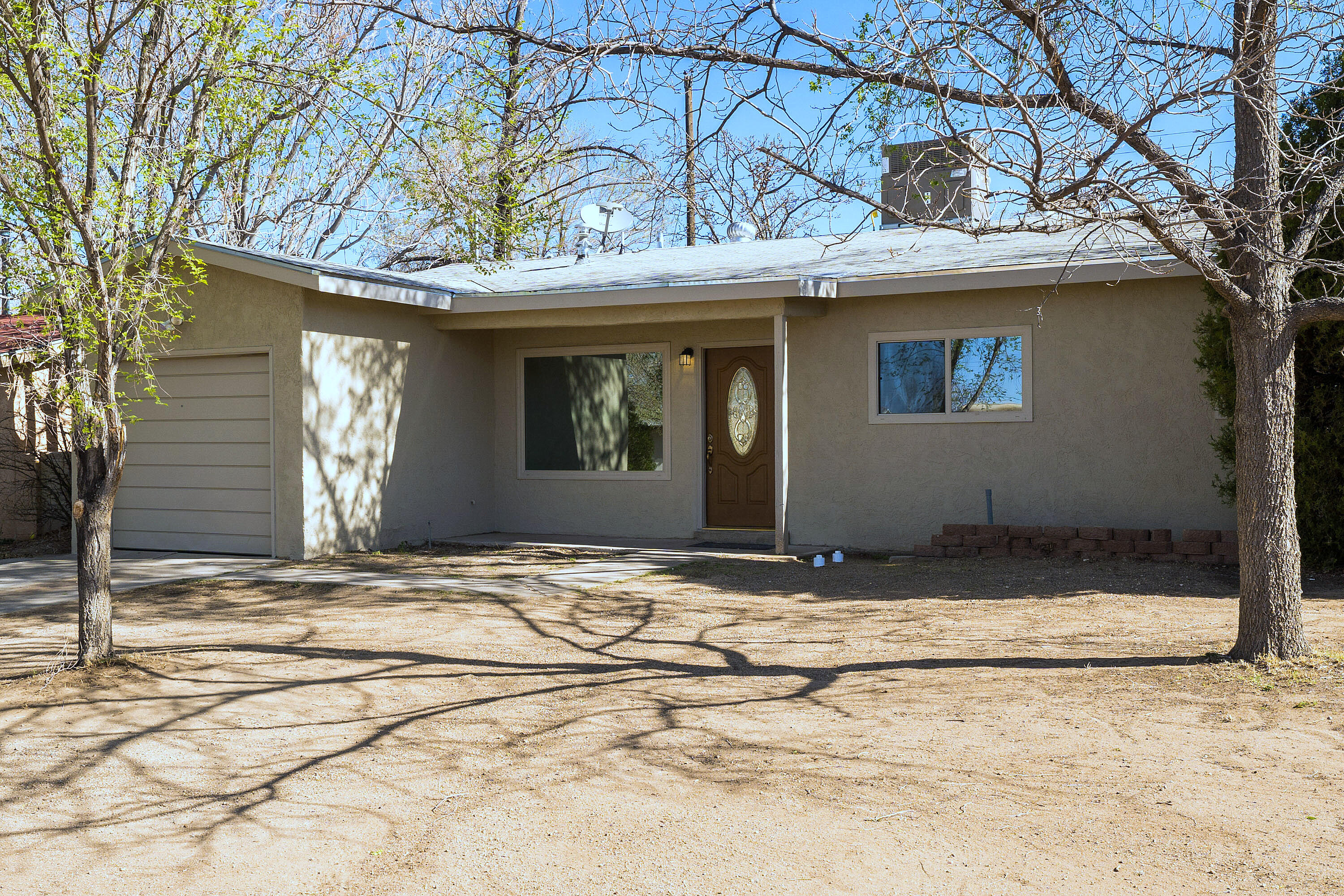 Single Story, detached 3 BR 1.75 BA 1 car garage on Constitution just West of Juan Tabo.  Updated, Refrigerate Air, New Kitchen and the kitchen appliances are included. Soft Close drawers, quartz counters.  Easy to maintain floors, updated bathrooms, Walled back yard!  NO HOA, bring your pets and your furniture because this is Move In Ready. Seller can accommodate a quick closing if needed.