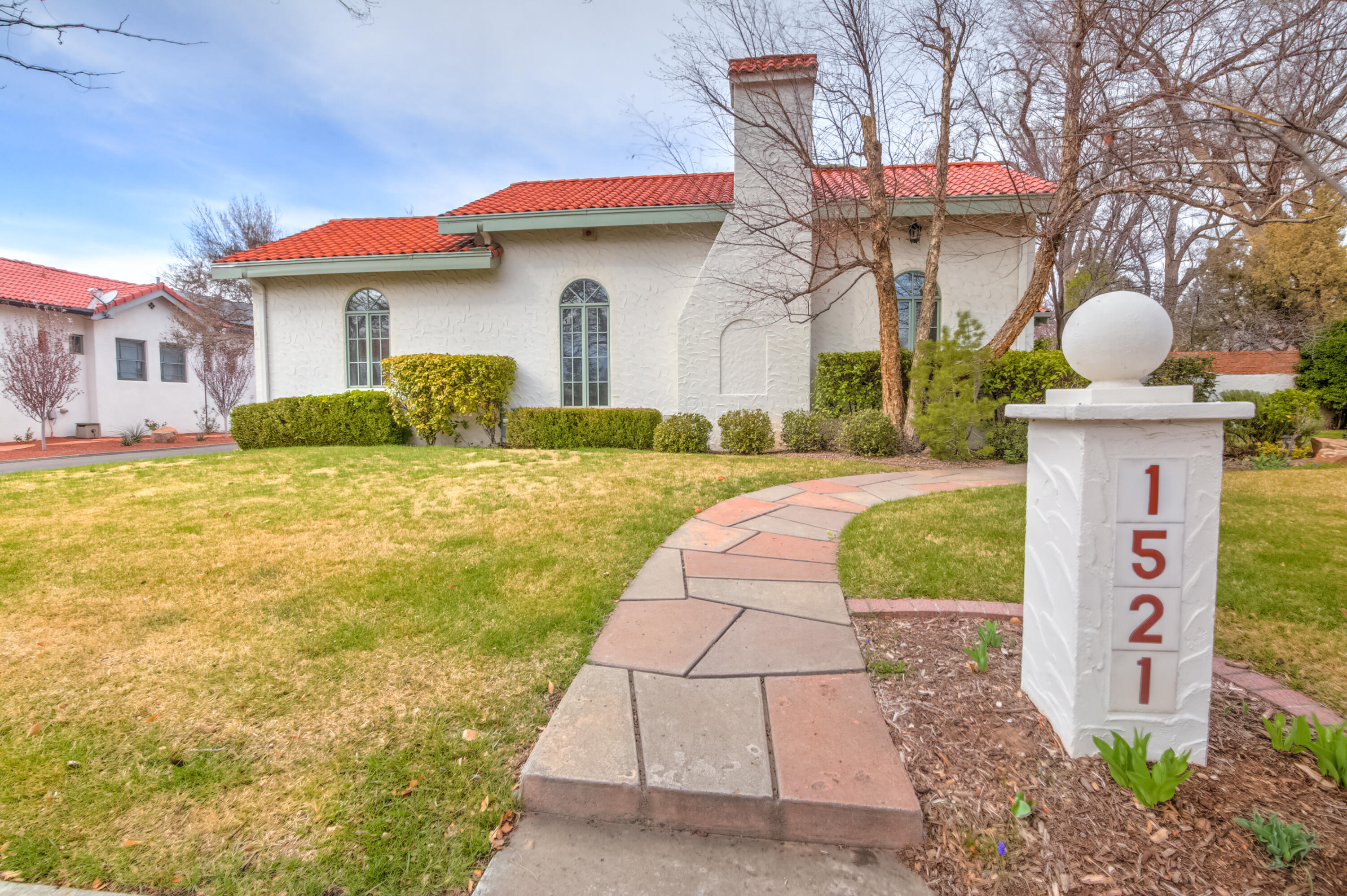 Absolutely stunning, a gem of the Albuquerque Country Club neighborhood. Constructed in 1931 on a spacious .35 acre lot with mature landscaping & trees. Very nicely appointed & updated while preserving many of the original details.  The home features 3,470 square feet on two levels plus a detached two car garage. The iconic arched window in the living space allows a flood of natural light & an open and airy feel with a custom fireplace. Just off the living room is the formal dining room large enough to host a number of guests. Original hardwood floors are beautifully cared for. The gourmet kitchen features stainless appliances, solid surface counters and custom cabinets. The daylight basement has a family room, bedroom, full bath and utility room. Way to many details to list, a must see!