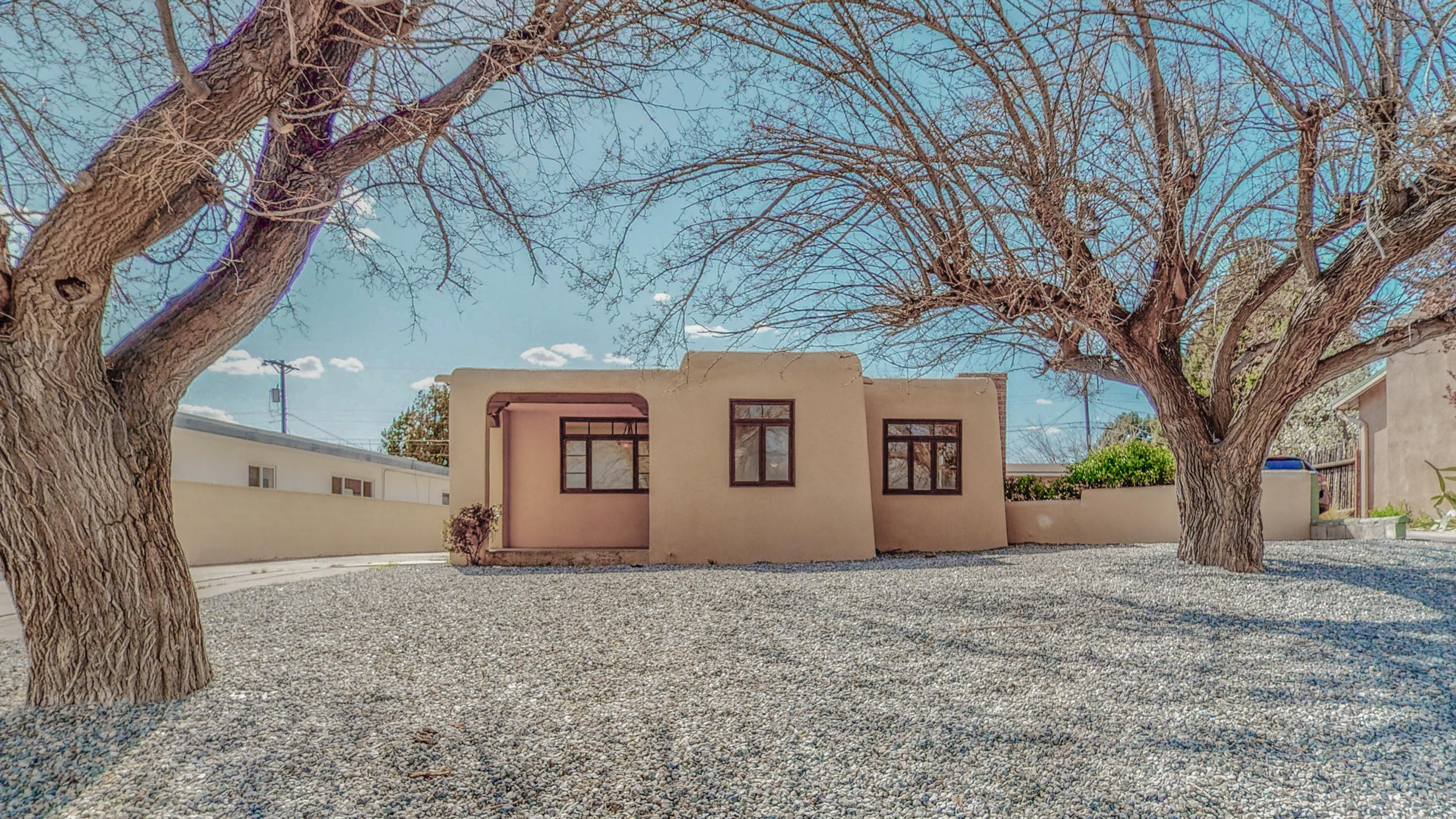 Charming 1950's pueblo, with so much original charm and light, plus fresh updates.  The original hardwood floors are in beautiful condition, and the bathrooms and kitchen have been nicely updated. Newly installed oven and dishwasher! Close to many convenient areas of town and amenities.