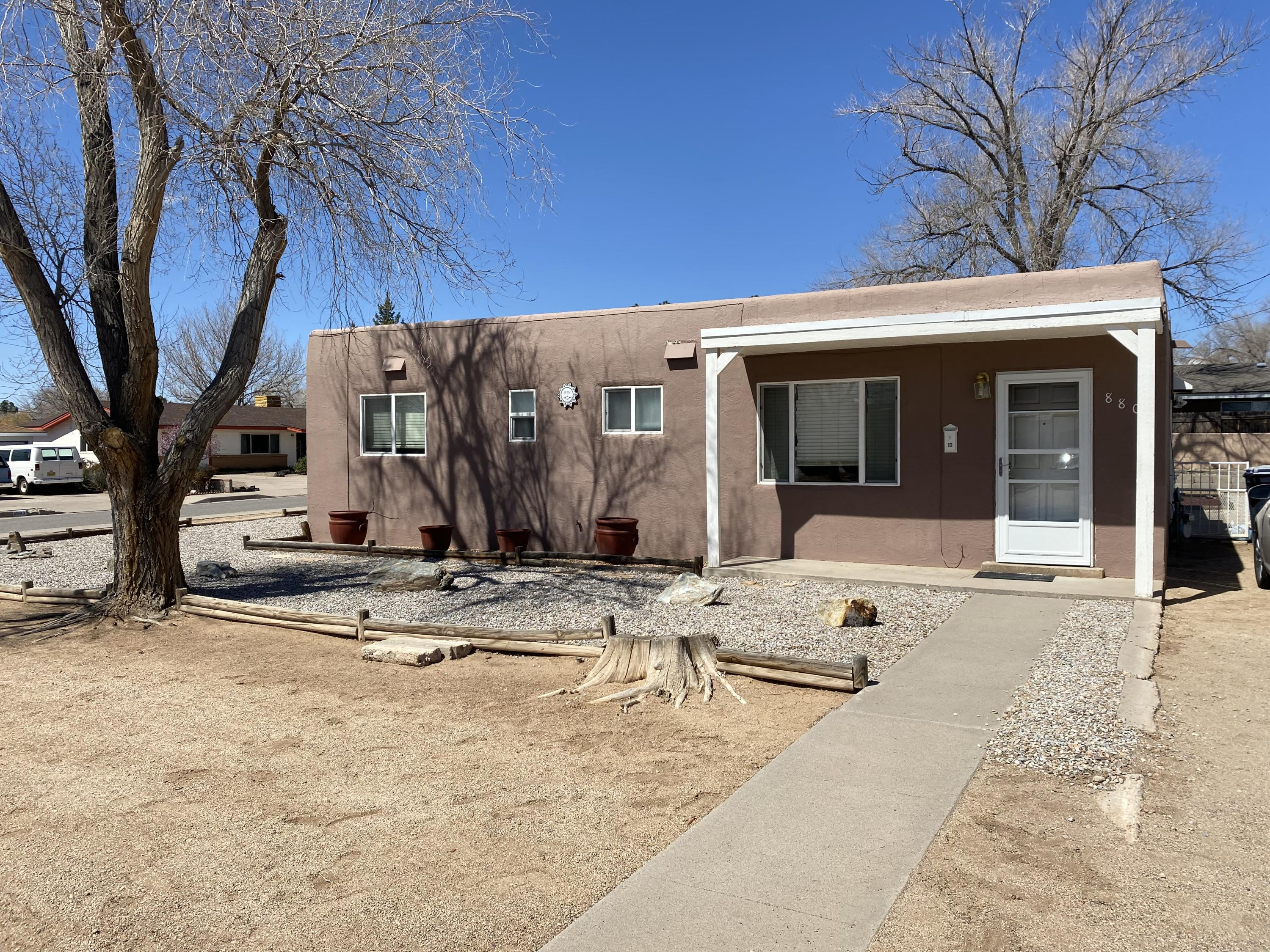 This 3 bedroom home has been meticulously upkept and is located on a huge corner lot in a great location.  It is located in the Sandia High School district and is walking distance to the elementary school - a definite must see!