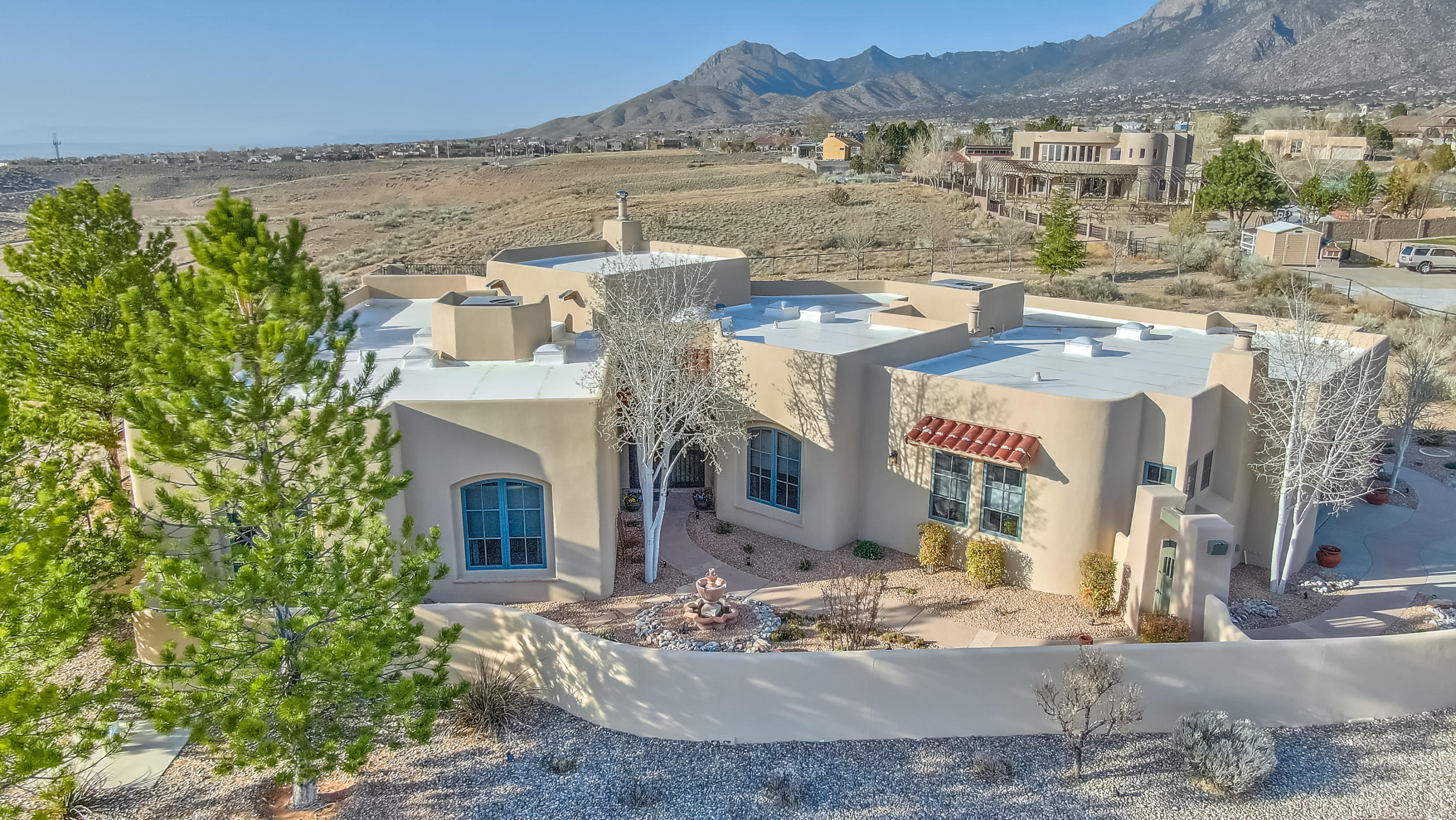 Exceptional View Lot, (City, Sandia Mountains, 3 other Mountains), Backs up to Open Space, Park & Equestian Park.  Gorgeous 1 level Home w/Possible In-law Quarters w/Gas, Log FP.  Kitchen w/Granite Counter Tops, 5 Burner Cooktop, Custom Cabinets w/Upper & Lower Lighting, Walk -in Pantry, Breakfast Area, plus  Formal Dining Room, Large Master BR & Spacious Master Bathroom w/Jacuzzi Tub, Separate Shower & Generous Master Closet, Great Room has Kiva Style GasLog FP, Built-in Book Shelves, Beautiful Wood Beam Ceiling Extensive Open & Covered Patios w/Gas Light FP, Spiral Staircase to Deck w/City & Mountain Views. Home has 11 Skylights & 8 Ceiling Fans, Beautifully Landscaped (Full Drip System), Hot Tub, Curtains in DR & 2nd, 3rd BR, Garage Refrigerator does not convey!!!