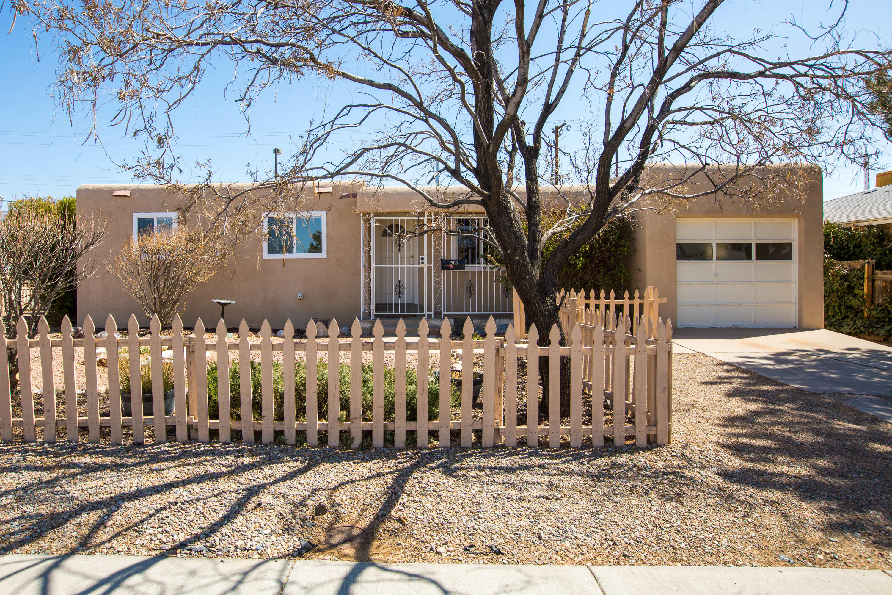 Super sweet one level ready for you to move right into!  New windows (except kitchen), electrical panel, evaporative cooler, carpet & vinyl flooring, new light fixtures in dining room, kitchen and laundry++ freshly painted too!! Water line from street to house replaced in 2012 and stucco done in 2016. Large living room with woodburning fireplace. Nice baths with tile shower surrounds! Roomy kitchen with portable dishwasher, gas range/oven and refrigerator stays!  Laundry with lots of storage cabinets and access to outside!  Located on large corner lot with gate for backyard access!! Nice floorplan! Large covered patio--great for entertaining!!