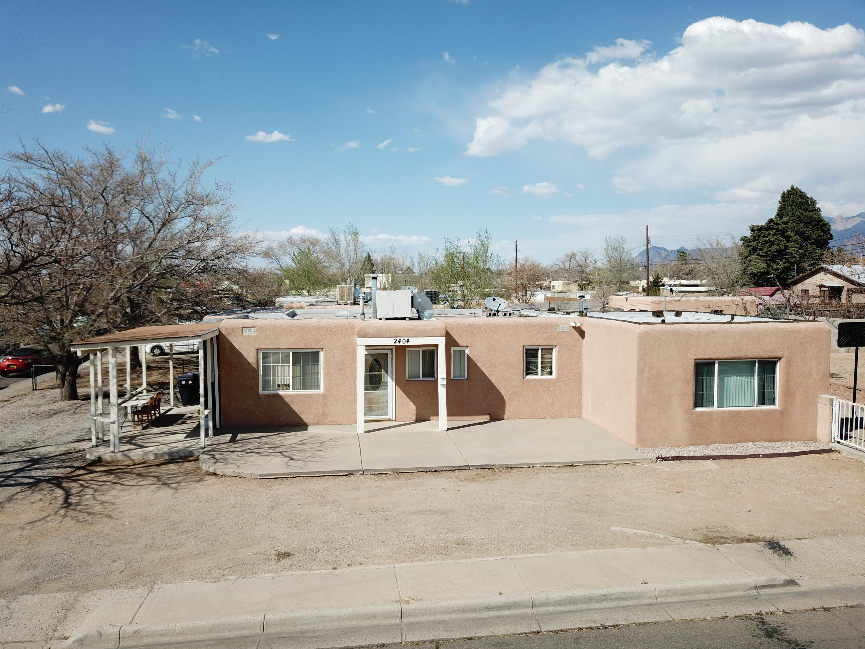 Don't miss your opportunity to call this NE heights gem your new home.  Location, location, location.  Conveniently located is close proximity to Coronado Mall, restaurants, shopping, I-40 & I-25.  This floor plan offers 3 bedrooms one bath.  Its situated on a corner lot with back yard access.  With strong offer seller will repaint the full interior of the property, and install new carpet, after tenants vacates the property.  Buyer can pick coloring of paint and carpeting. Enjoy the gorgeous NM weather in the backyard and enjoy the views of the Mountains.  Schedule your showing soon.  It won't last long.