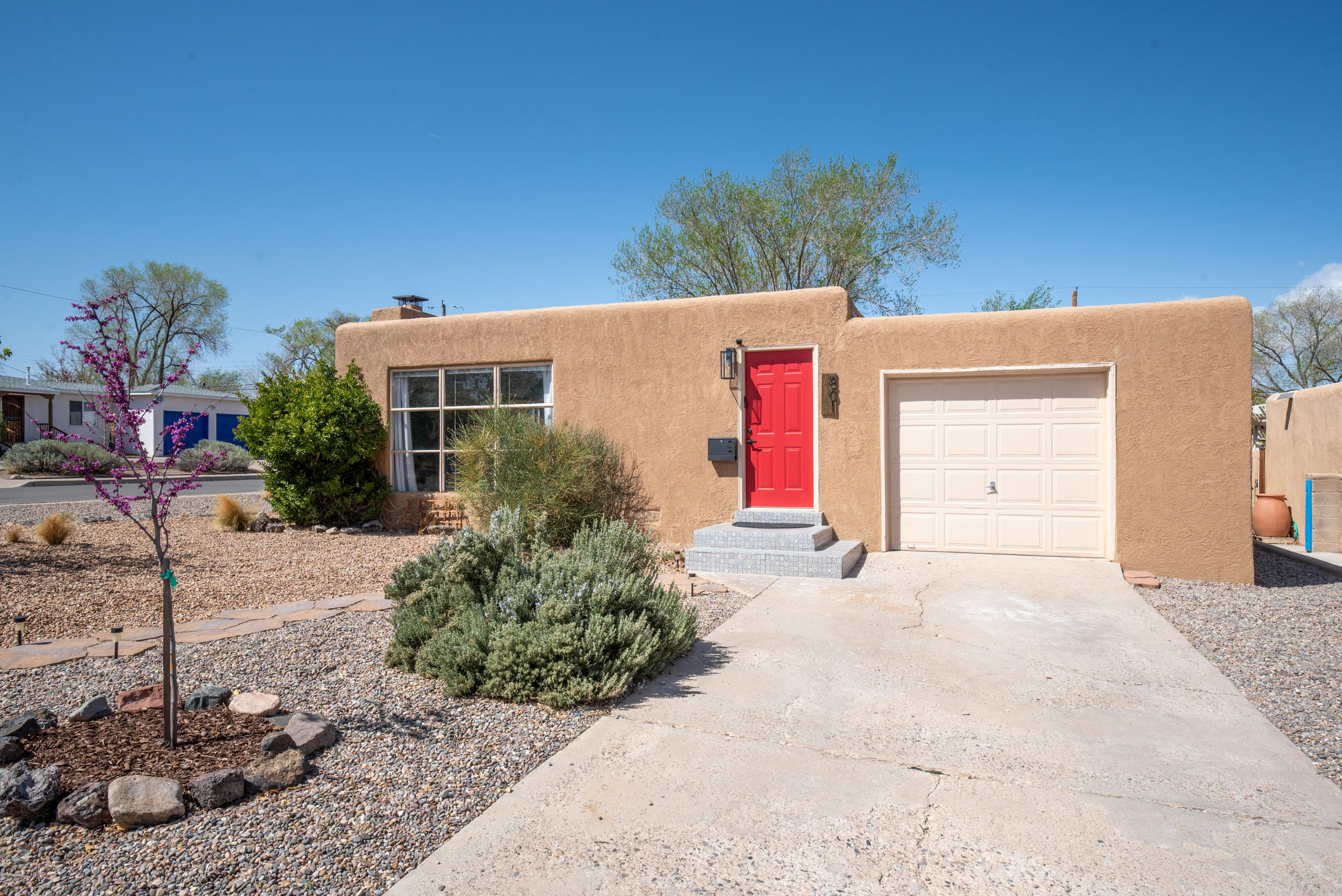 UNM!! CORNER LOT!!  HUGE BACKYARD!  Beautifully updated 3BDR/2BA/1CG home!!  Beautiful wood flooring!  Open floor plan features a great room/dining room with wood fireplace & large picture window showcasing mountain views!  Updated kitchen with tile flooring, track lighting, gas range, SS built-in microwave, refrigerator & dishwasher!  Washer & dryer stay!  Updated full bath and master bath!  Updated water heater!  Finished 1CG makes a perfect exercise room!  Incredible outdoor living space featuring a pergola covered patio & open patio, raised garden beds, trees & shrubs, wood bar/table, perfect for Summer BBQs, outdoor dining & gatherings, lots of room to entertain family and friends!  Excellent location close to UNM, Nob Hill, Uptown, Altura Park, shopping & restaurants!