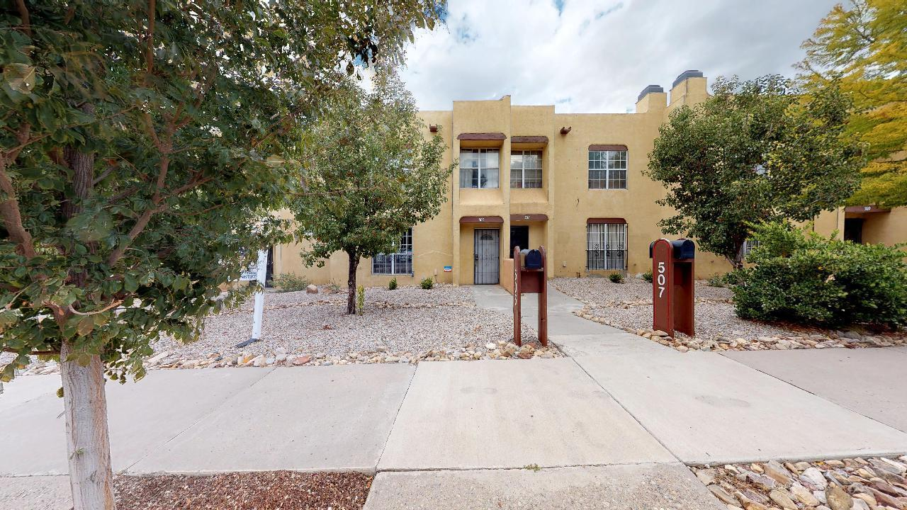 LOCATION IS KEY!!! This Spectacular town  home is located in the Heart of the City & is located near UNM, Loveless & Presbyterian Hospitals, CNM, Museums, Shopping & Schools. Close to the public transit and just minute away from the freeway. This light and bright Home features a full sized detached two car garage, private back yard, cozy living area with a wood burning fire place and a newer TPO roof on both structures. Come live the City Life in Down Town Albuquerque.