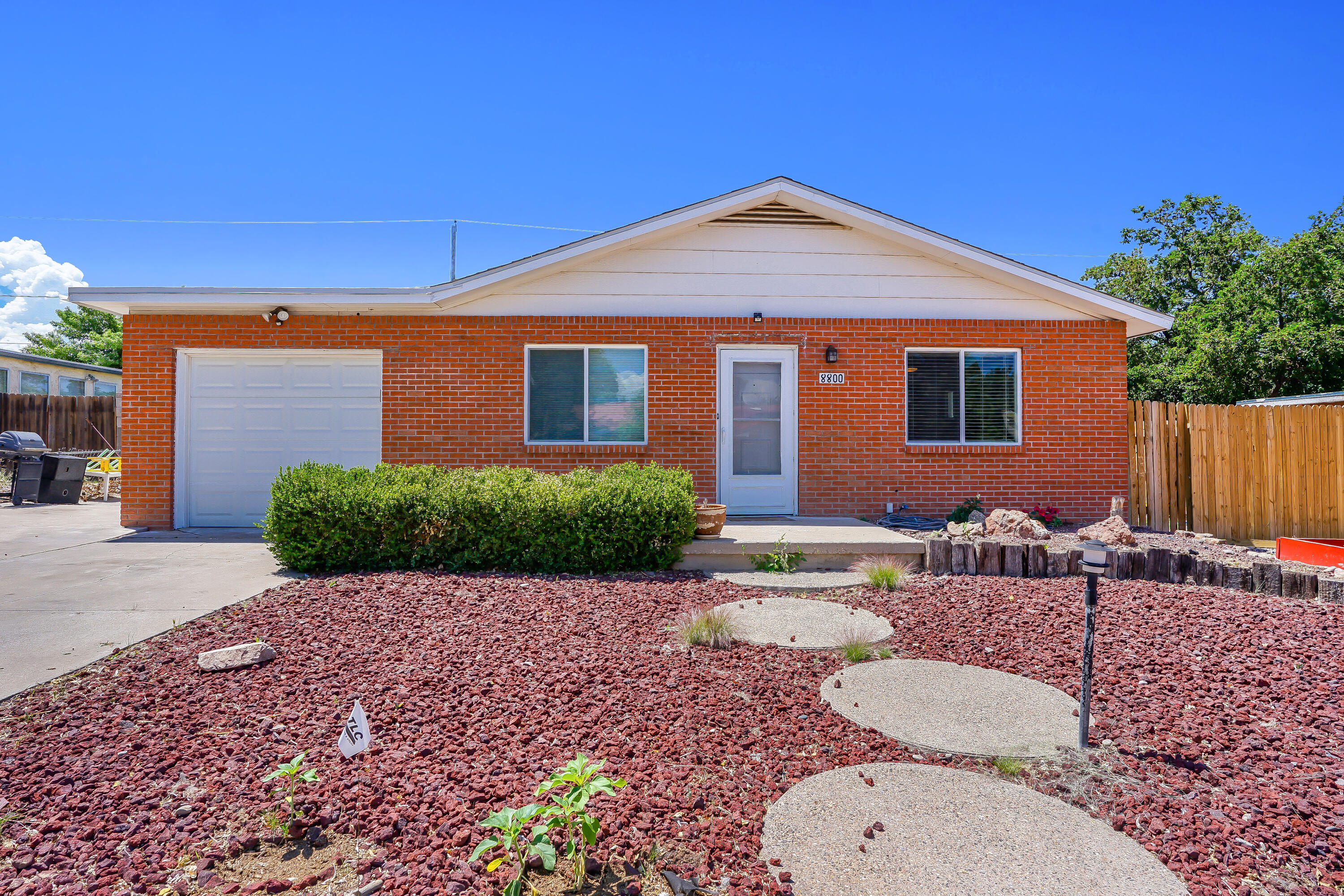 Back on the market!!  Come check out this cozy gem in the NE Heights. With a spacious, open floor plan. Lots of natural light throughout. Enjoy time in an enclosed sunroom or out under the pergola.New windows, newer roof and new stucco make this house move-in ready!