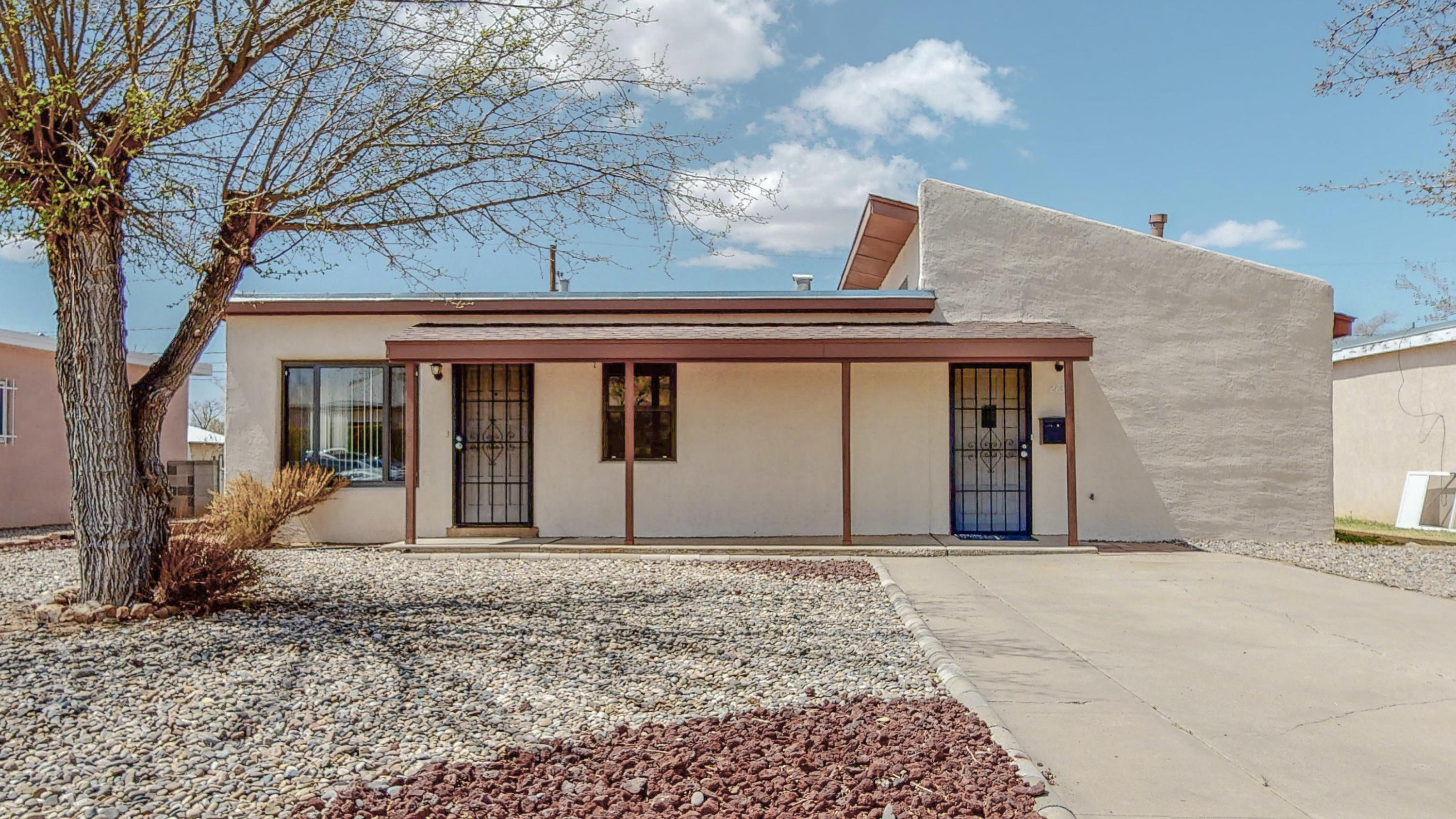Can we talk about prime location?  Close to shopping and restaurants, you're only minutes from I-40 to reach any area of Albuquerque quickly.  This home features two living areas and three bedrooms.  If you are in need of backyard access, this has a cement slab just inside the large gate in the back.   The large storage shed is a huge perk if you like to tinker, work on cars, wood build or need a man cave/she shed.  Come see it today, it won't last long.