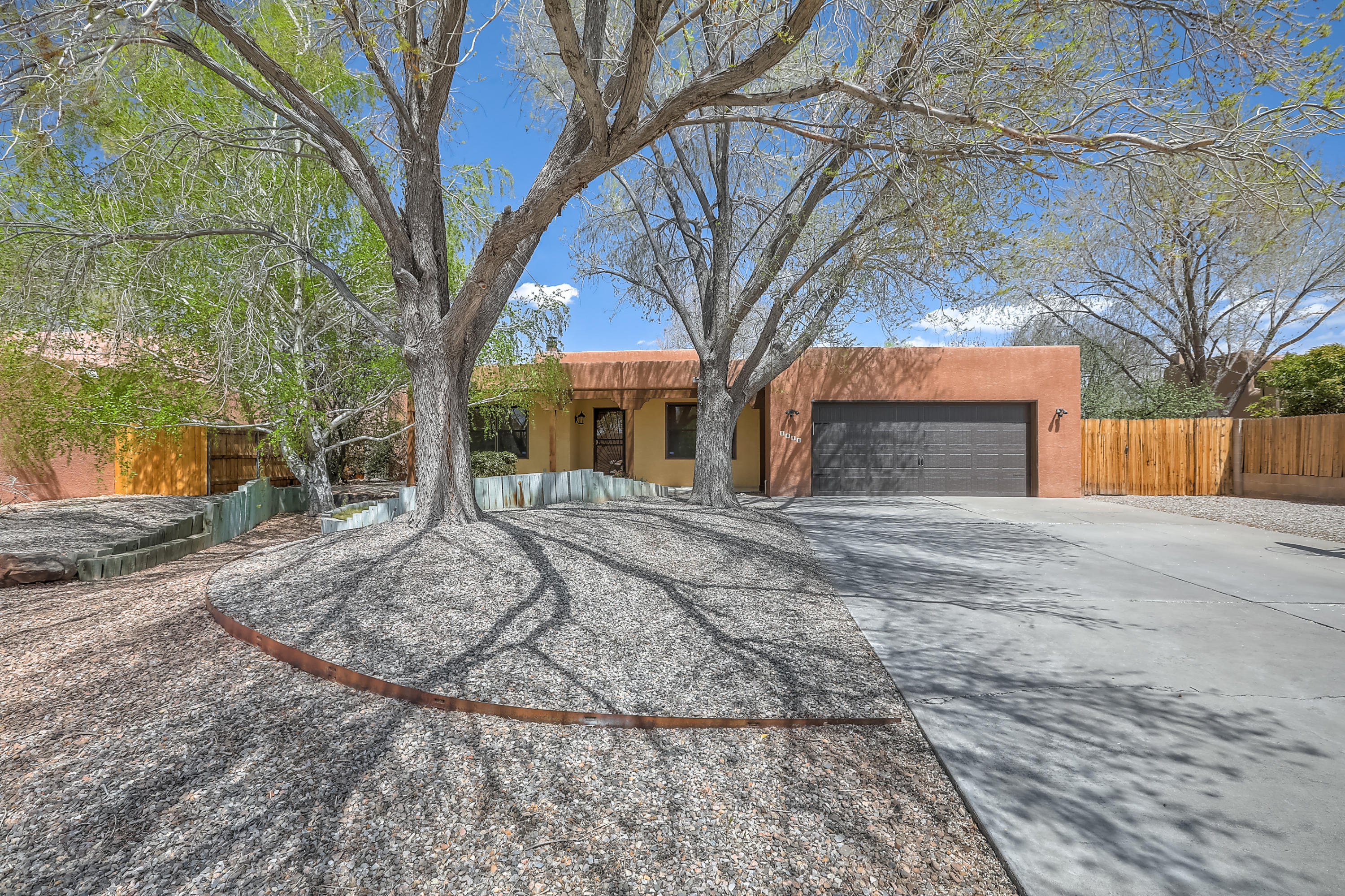 Beautiful Southwest Contemporary home in Matthew Meadows! Open floor plan, skylights, formal living/dining rooms, 4 beds/3.5 baths, including 2nd MBR w/ full bath & gorgeous bay window and separate owner's suite w/ walk-in closet, jetted tub, & adjoining office.  Lovely backyard & patio with mature shade & fruit trees.  New HVAC/furnaces (2020), hot water heater (2018), & garage door/motor (2018). Located in the heart of North Valley  with many nearby amenities, this home is an Albuquerque oasis.