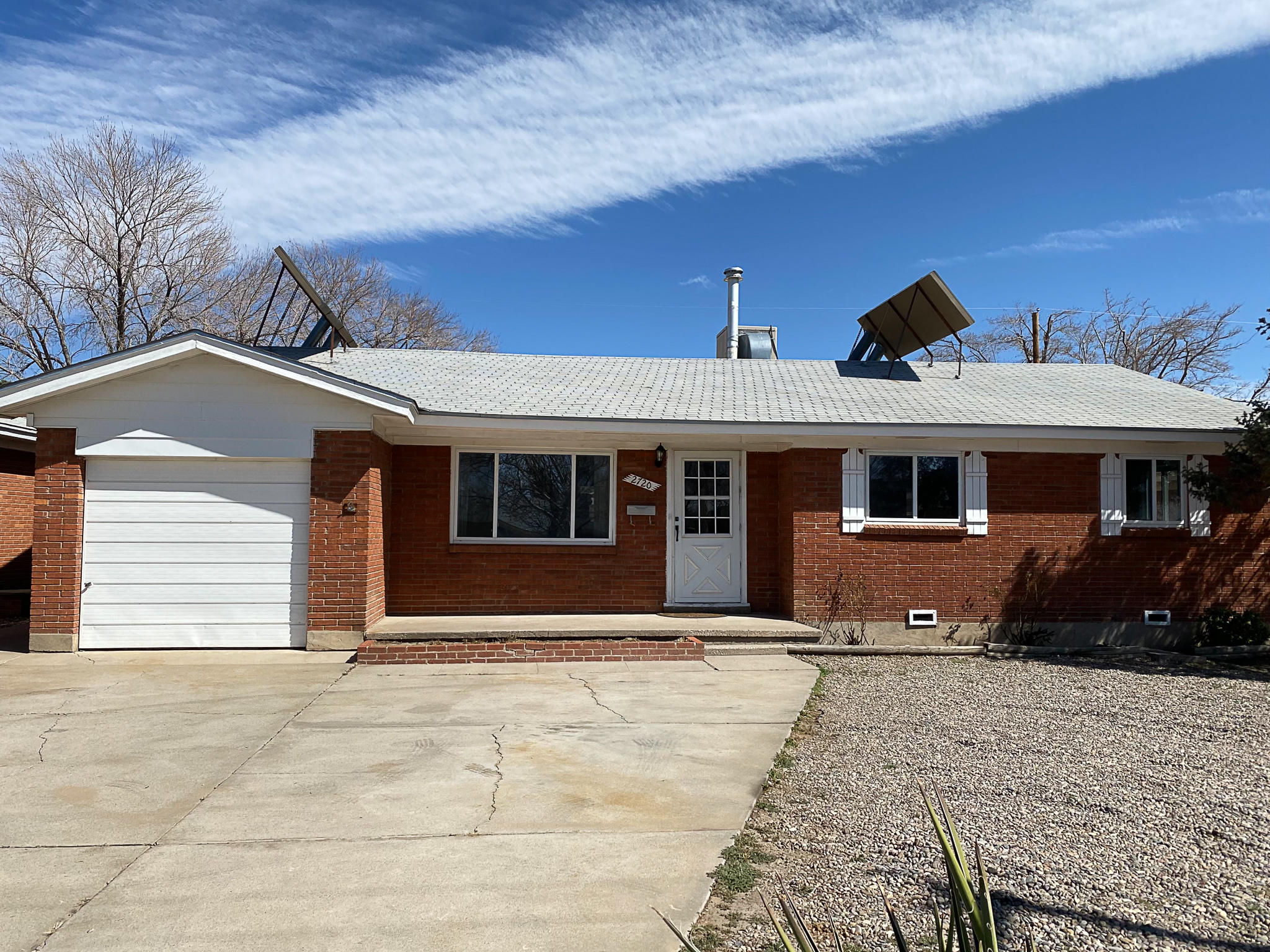 Brick single level charmer in the heart of Uptown! White oak hardwood floors and vintage scraped ceiling with plaster crown moldings adorn the living room. Kitchen features solid wood custom cabinetry, gas stove and all appliances stay. Move in ready 3 BR 2 Bath owned by the same family for over sixty years. Many updates including windows, electrical panel and evaporative cooler in 2020, and CFA furnace approx 3 years young. Garage has been partially converted and adds a 11 X12 heated bonus room for hobbies or work out space. Large service room with storage. Solar system on roof generates additional heat in the cold months. Enjoy Sandia mountain views from the large backyard with plenty of room to garden. Storage shed has power and electric for your projects. Convenient to all you need-