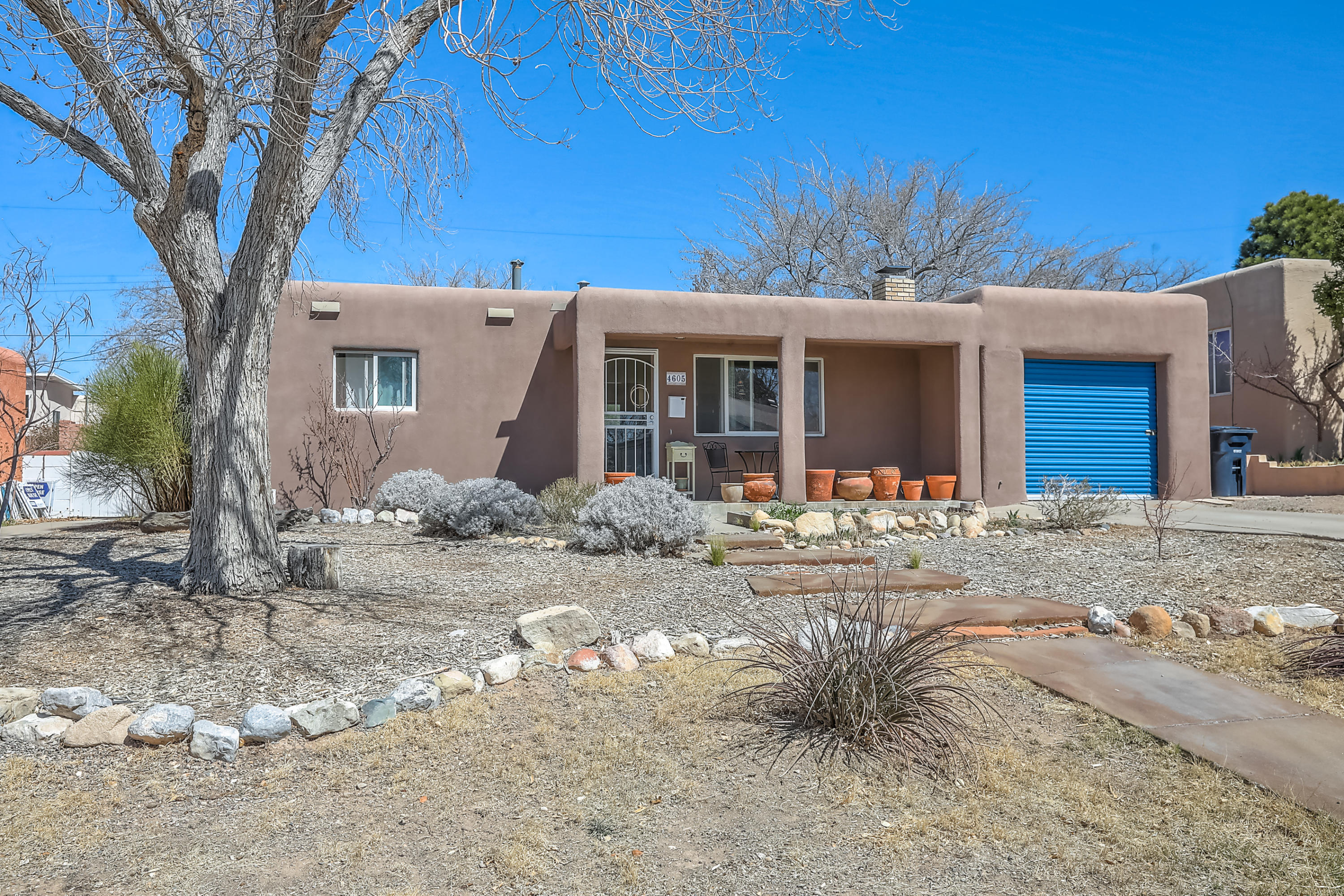 Come home to your sun-filled pueblo bungalow in desirable Ridge Park neighborhood! Classic old-Albuquerque style w/original hardwood floors in living & bedrooms, plastered walls, arched doorway, bull-nosed corners, built-ins & custom brick wood-burning fireplace. The beautifully remodeled kitchen showcases custom wood/glass cabinets, stainless appliances & ceramic backsplash, countertops & floor. Updated bath w/tile accents & pedestal sink, & classic hallway built-in linen shelves. Anderson Thermal windows throughout. The glass kitchen door opens to a spacious patio & private backyard complete with flagstone patio, dog run(could also be garden area) and awesome raised vegetable gardens. This superb location is close to UNM, Nob Hill, Midtown, I40/I25, Coronado/Uptown, bike trails & parks.