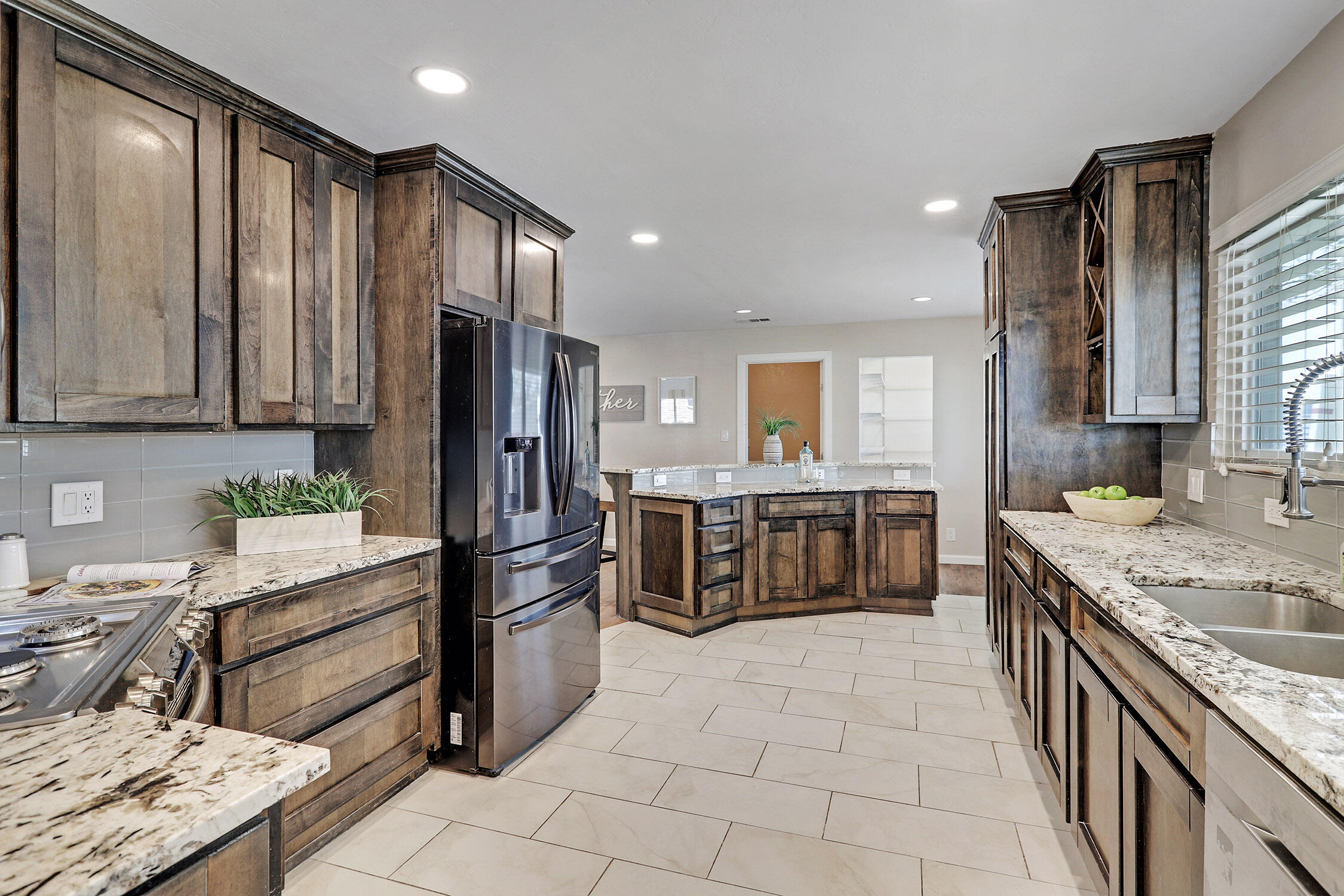 Open House this coming Saturday and Sunday 12-2 pm. Custom uptown gem! Great location in an established neighborhood. This home has been totally updated throughout. Beautiful kitchen with custom cabinets high-end granite,  dimmable LED lighting throughout house. Huge master suite incredible custom master shower with multiple shower heads, large walk-in master closet with built ins. Great covered patio with plenty of room to lounge and entertain. Best yard in the city with 12 putt putt holes for the family. Artificial turf front and back on a huge corner lot.  Backyard access is a plus.