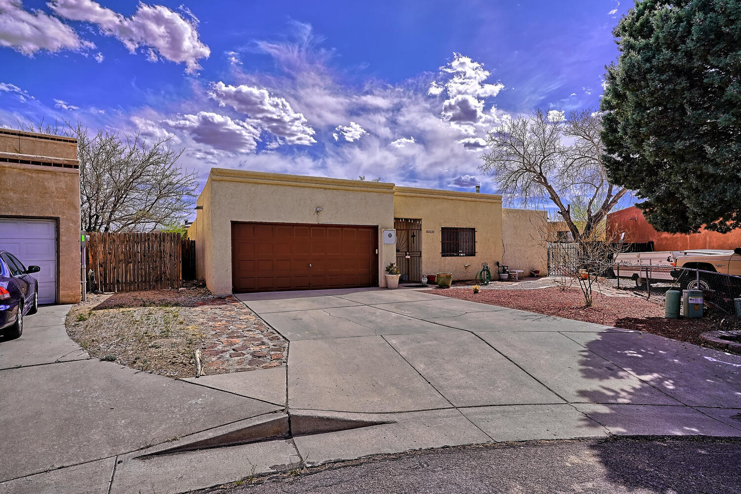 Great west side home featuring a HUGE living area, formal dining room, sitting room and bar area great for family gatherings or entertaining.  Back yard patio great for relaxing in the evenings. Quick access to I40 via Unser or Coors.