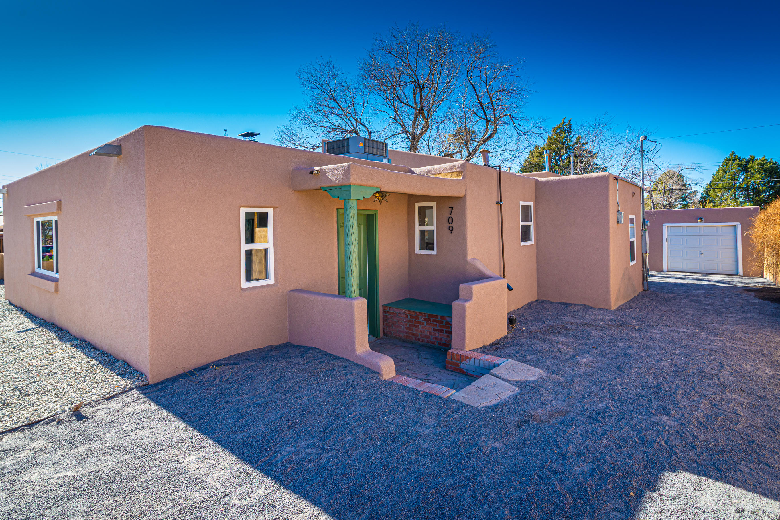 Beautifully updated home in the heart of Albuquerque!! Gorgeous living room with a high ceiling!! Kitchen is equipped with quartz countertops and stainless steel appliances!! HUGE lot!! New Stucco and refrigerated air!! Schedule your appointment to see this home today!!