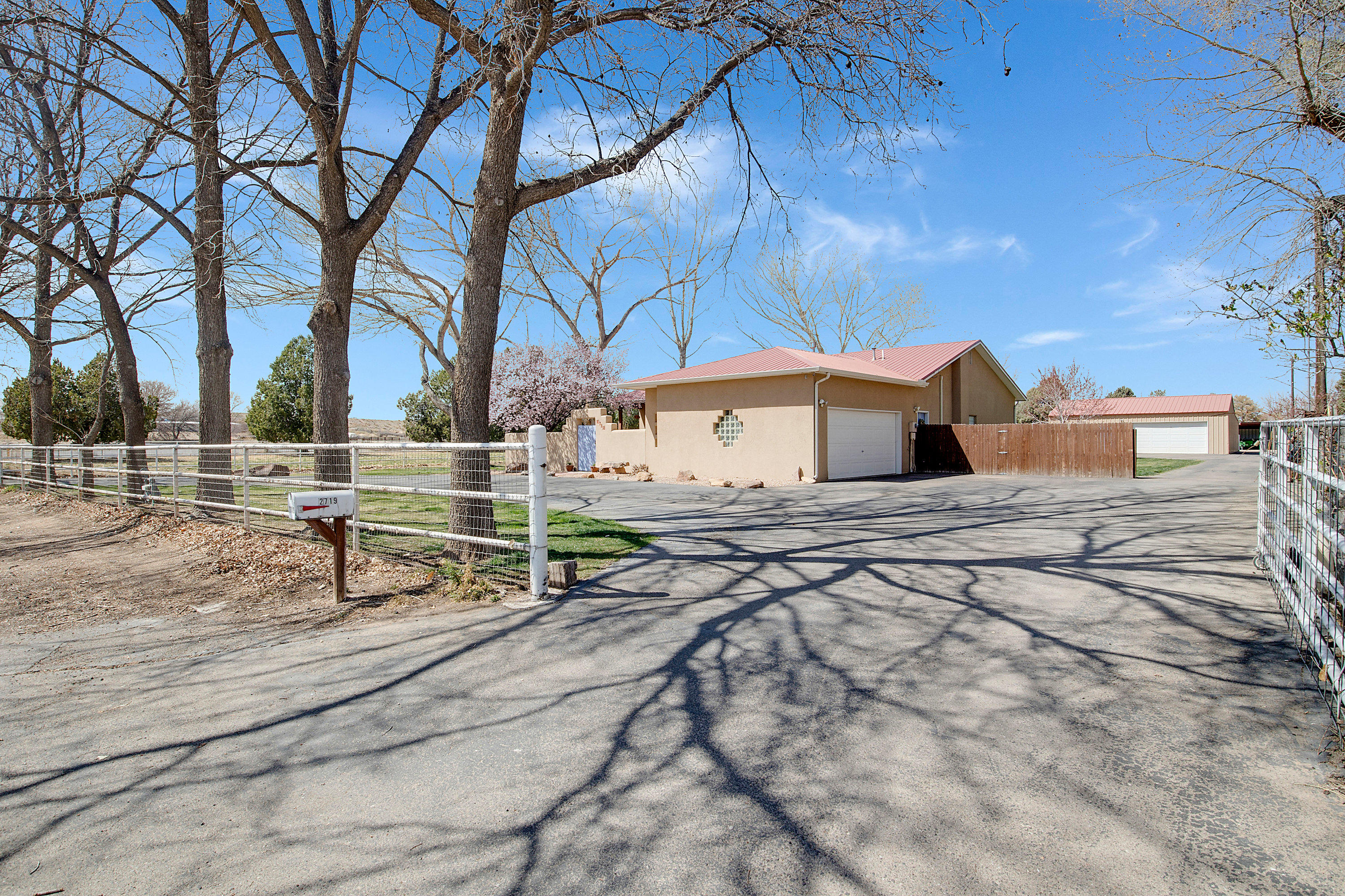 Outstanding, turn-key 2-acre horse property! Or great location for car enthusiast or hobbyist! Top quality, custom home with loads of charm- vigas, nichos, wood-grain tile floors (2014) in living areas & newer carpet (2016) in bedrooms. Huge, open great room with kiva fireplace, wonderful bright & airy family or hobby room, peaceful master suite with large bedroom, jetted tub, separate shower, double sinks, walk-in closet. Refrigerated air, radiant in-floor heat (even in oversized, 2-car garage with workshop & storage!) Plus horse facilities for 6 or more horses on fully pipe-fenced & MRGCD irrigated 2 acres with fruit & nut trees! AND a huge, detached 2000 SF shop space with heating & bathroom! Between garage & shop you could park 8 or more cars!